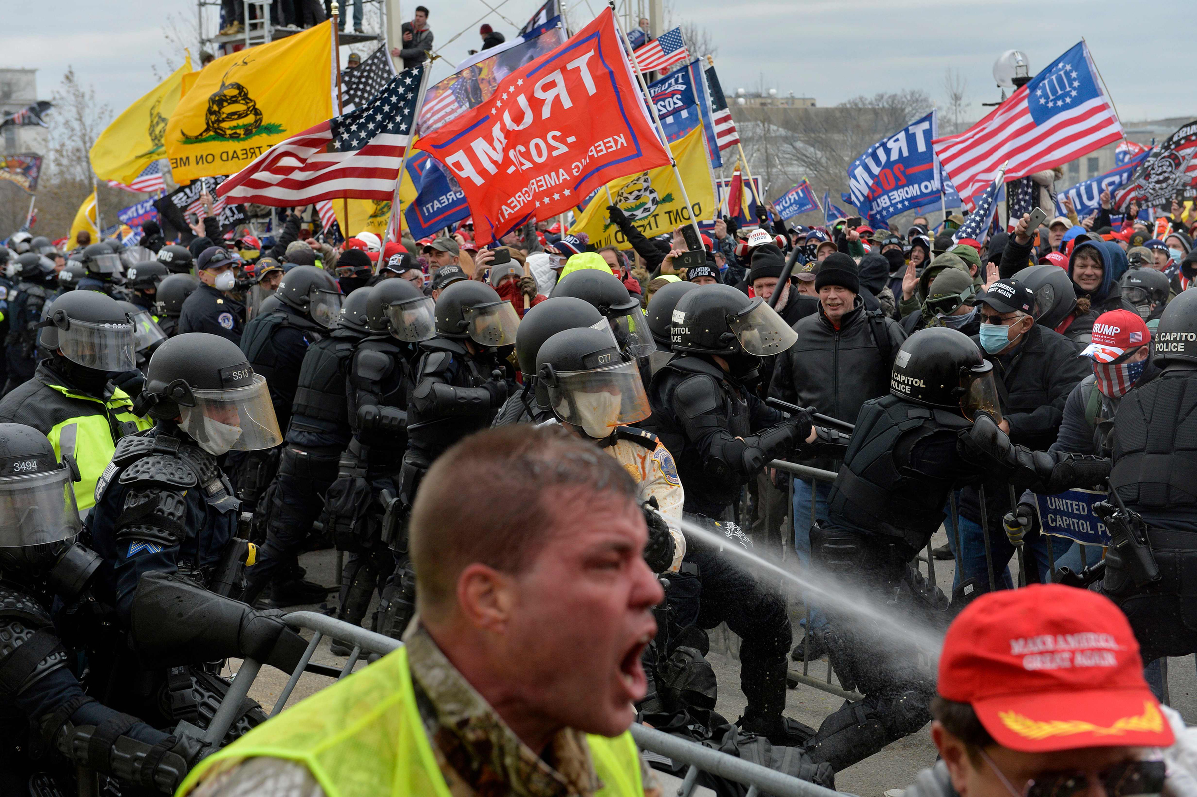 Trump supporters clash with police and security forces as people try to storm the Capitol building in Washington D.C. on Jan. 6, 2021.