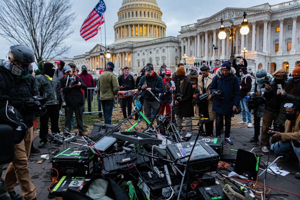 Pro-Trump protesters attacked the press pool outside the Capitol building and then destroyed their TV production gear. Pro-Trump supporters and far-right forcesflooded Washington DC to protest Trump's election loss.