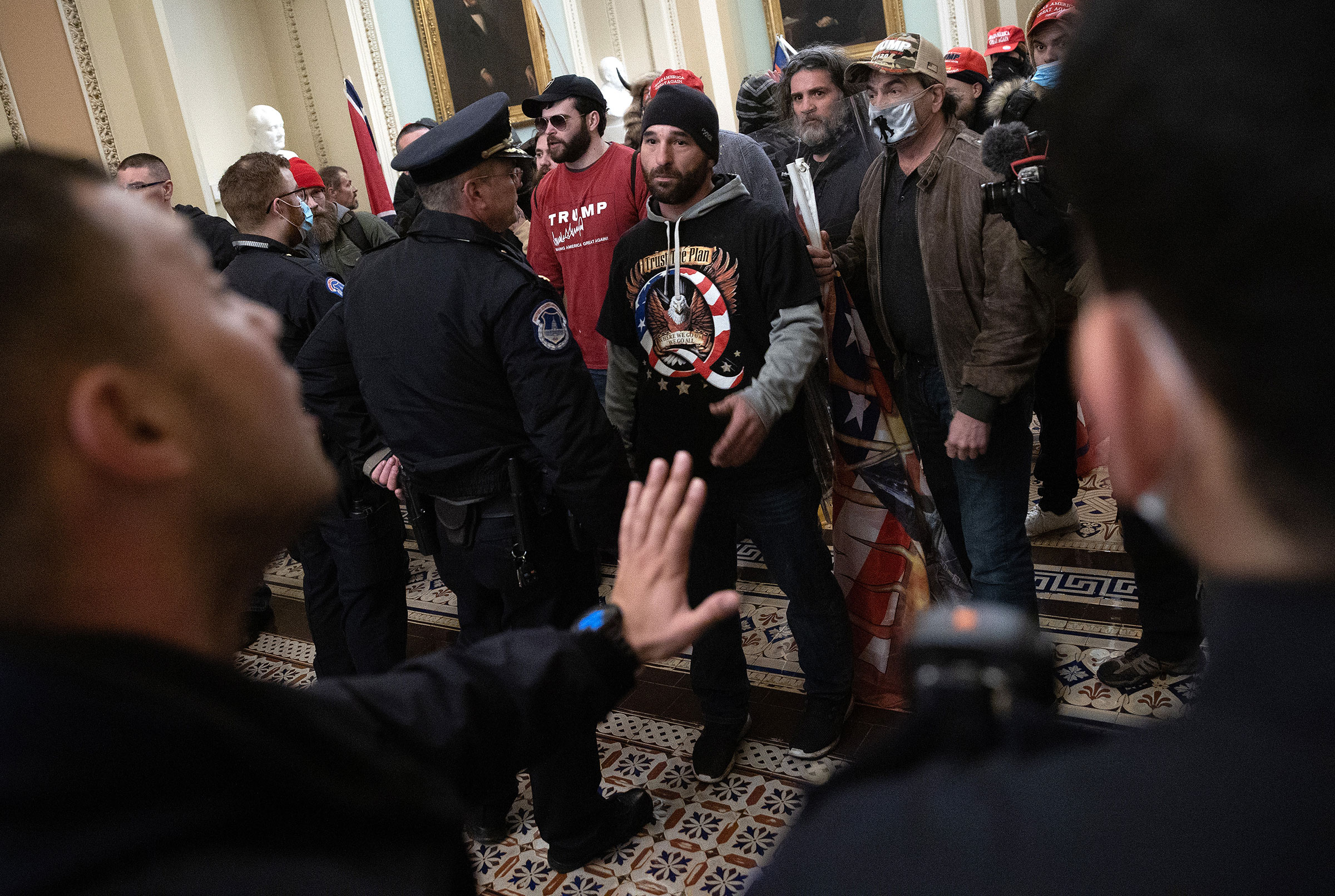 A pro-Trump mob confronts U.S. Capitol police after the group stormed the building on Jan. 06, 2021.