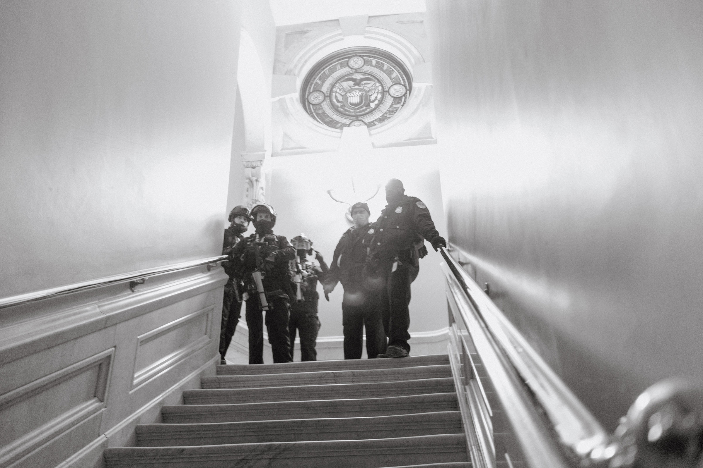 Capitol police seen at the top of a staircase inside the Capitol after a mob of Trump supporters broke in.