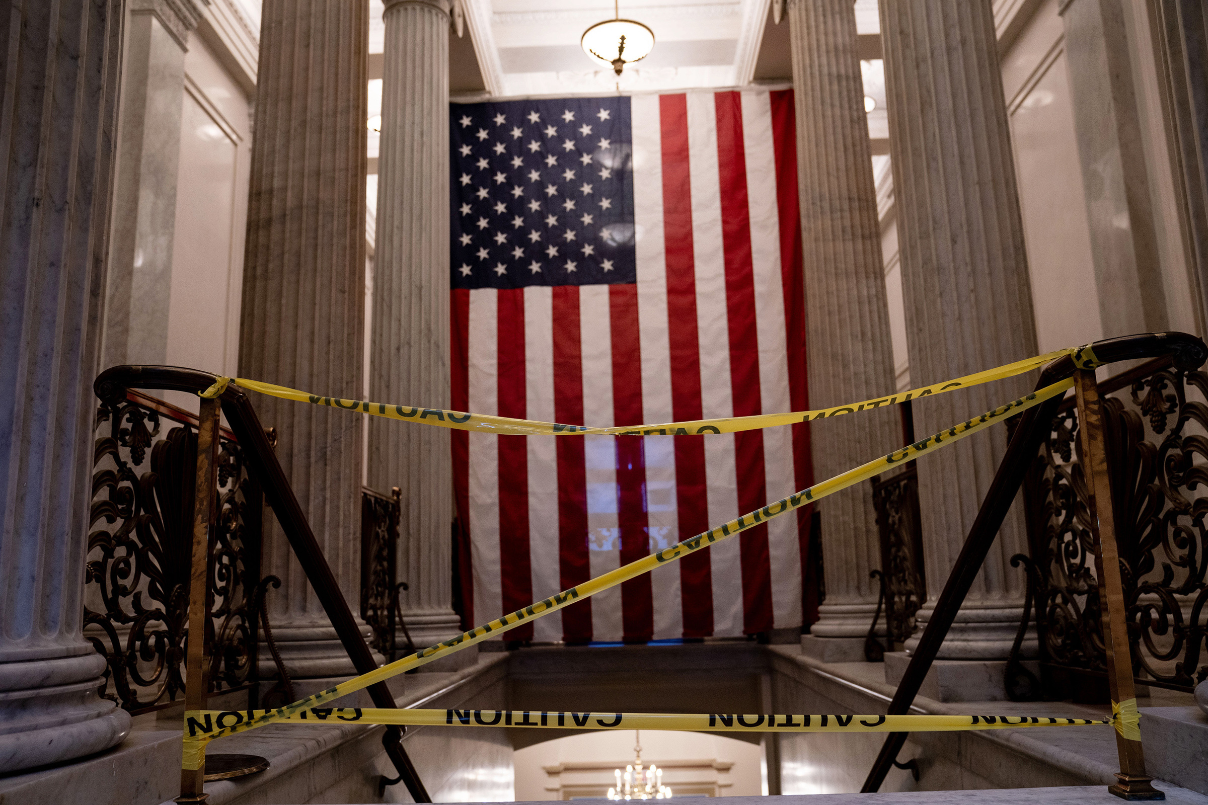Caution tape blocks a stairwell inside the Capitol in Washington on Jan. 9