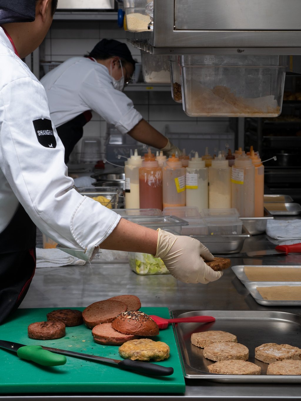 Staff at the BrewDog pub in Shanghai flip meat-free burgers