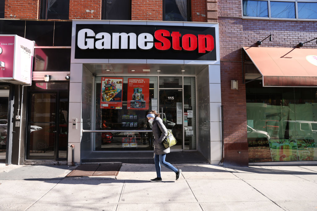 NEW YORK, NEW YORK - JANUARY 28: People walk by a GameStop store in Brooklyn on January 28, 2021 in New York City. Markets continue a volatile streak with the Dow Jones Industrial Average rising over 500 points in morning trading following yesterdays losses. Shares of the video game retailer GameStop plunged.