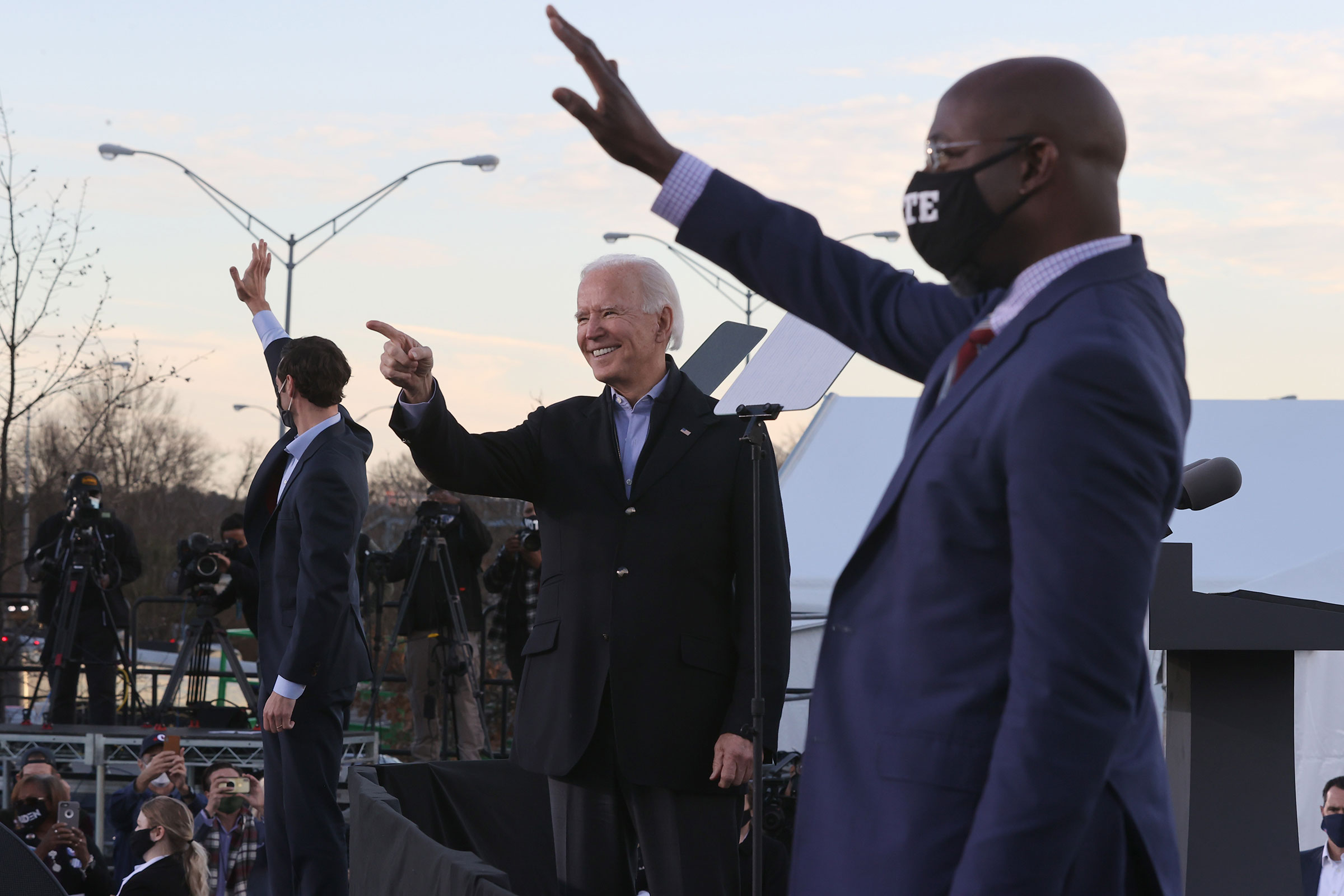 President-elect Joe Biden along with democratic candidates for the Senate Jon Ossoff and Rev. Raphael Warnock greet supporters during a campaign rally the day before their runoff election in Atlanta, on Jan. 04, 2021.