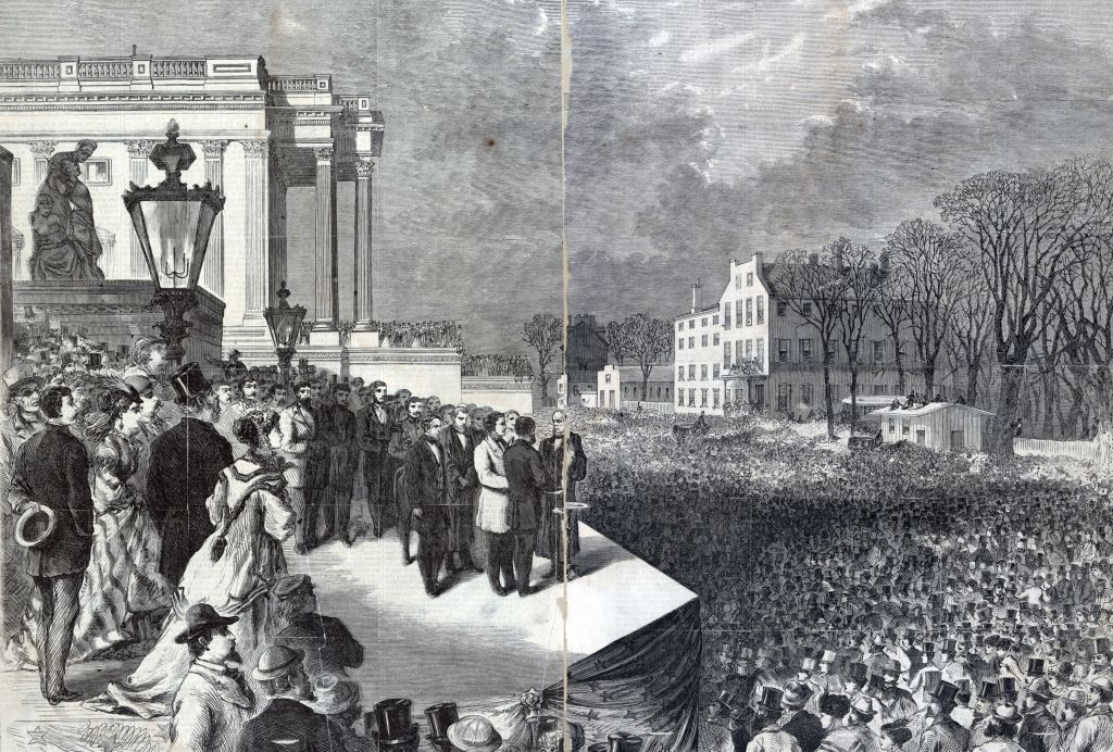 Ulysses S. Grant and Schuyler Colfax taking the oath of office administered by Chief Justice Salmon P. Chase on the east portico of the U.S. Capitol in Washington, D.C, March 4, 1869, before a large crowd.