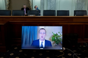 Mark Zuckerberg, founder and CEO of Facebook, testifying remotely during a Senate hearing on Section230, onOct.28