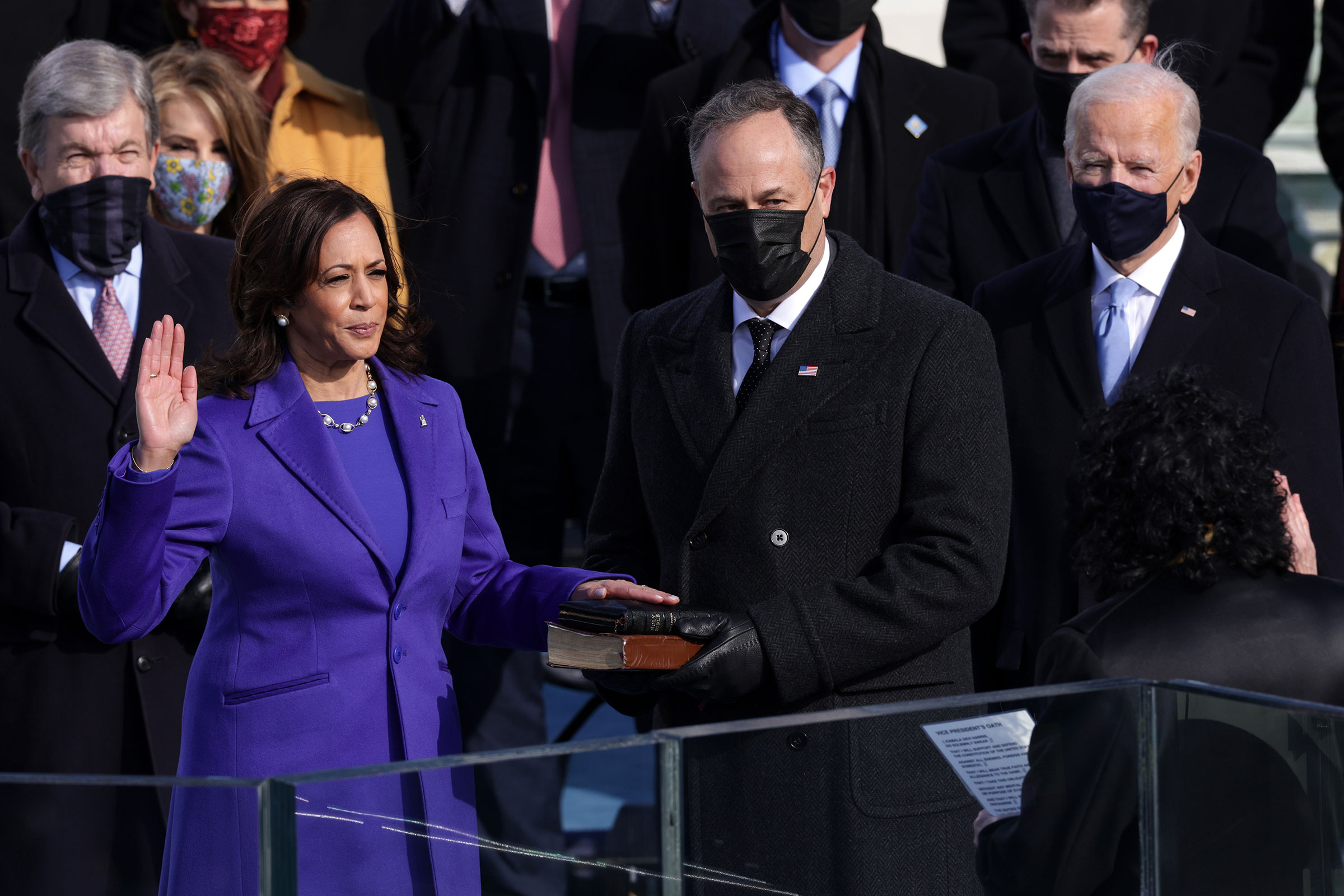 Kamala Harris is sworn in as Vice President of the United States as her husband Doug Emhoff looks on, in Washington on Jan. 20, 2021.