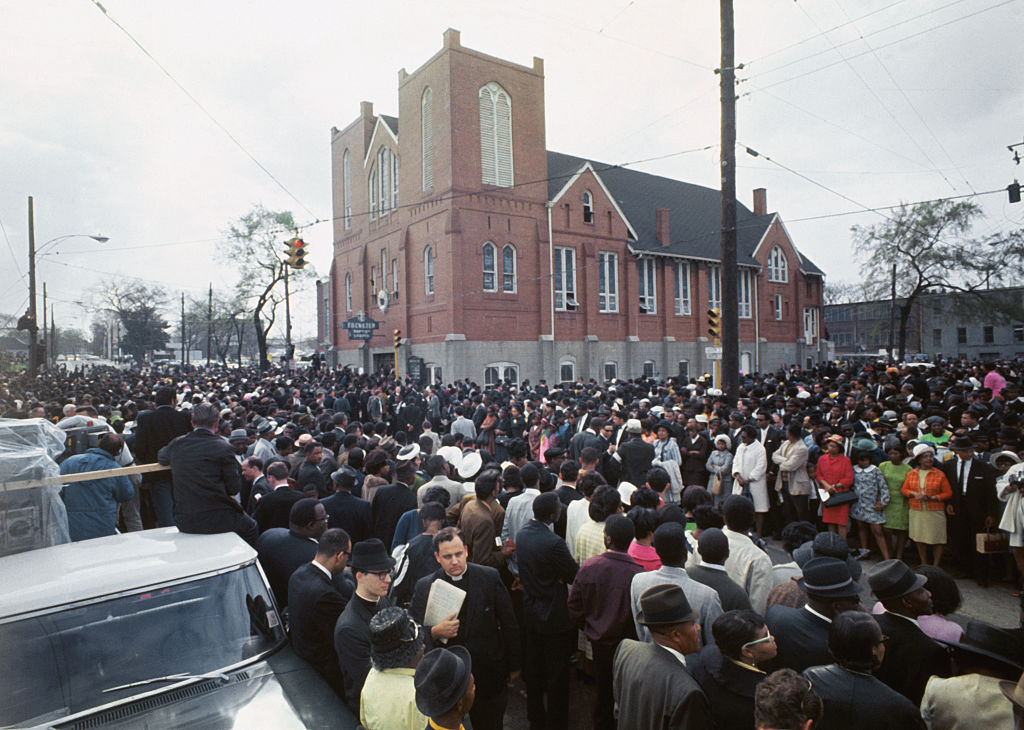 Thousands of funeral marchers gathered outside Ebenezer Baptist Church prepare to walk five miles to Morehouse College where another service for the slain Dr. Martin Luther King, Jr., will be held, April 9, 1968.