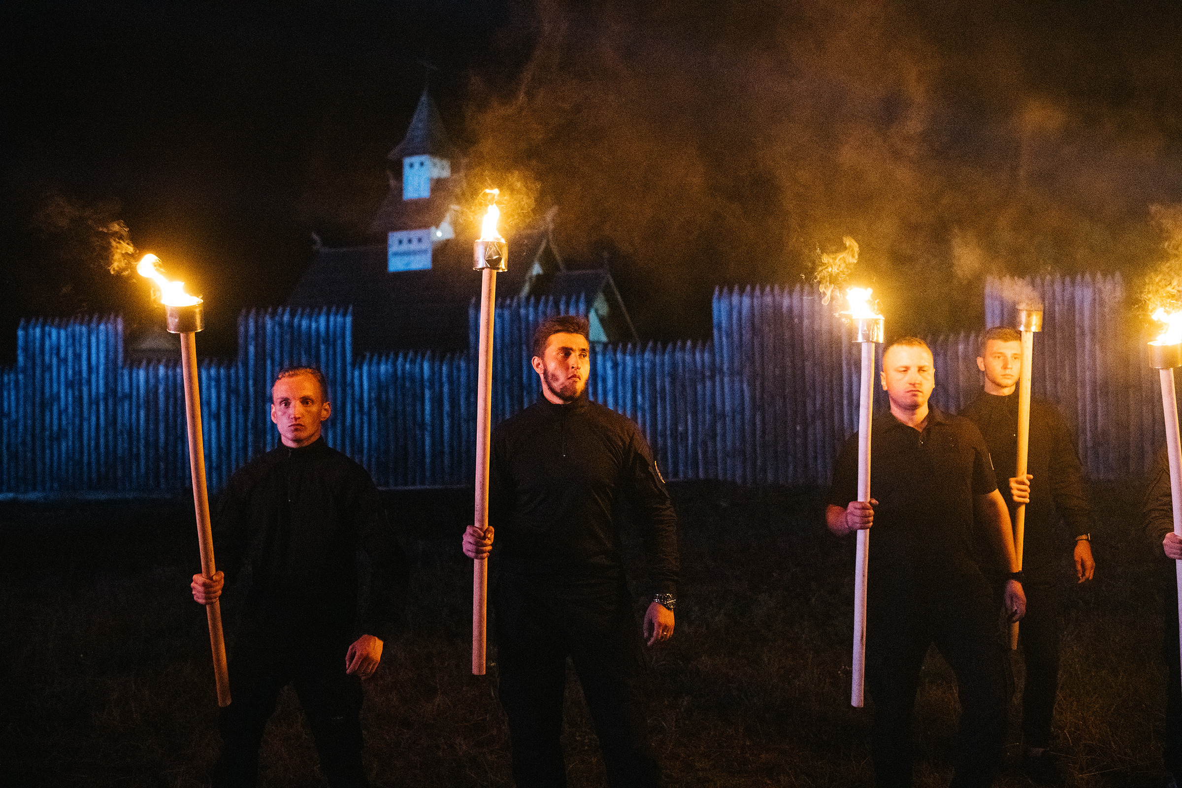 Azov members preparing to take part in a torchlit march at the Young Flame festival.