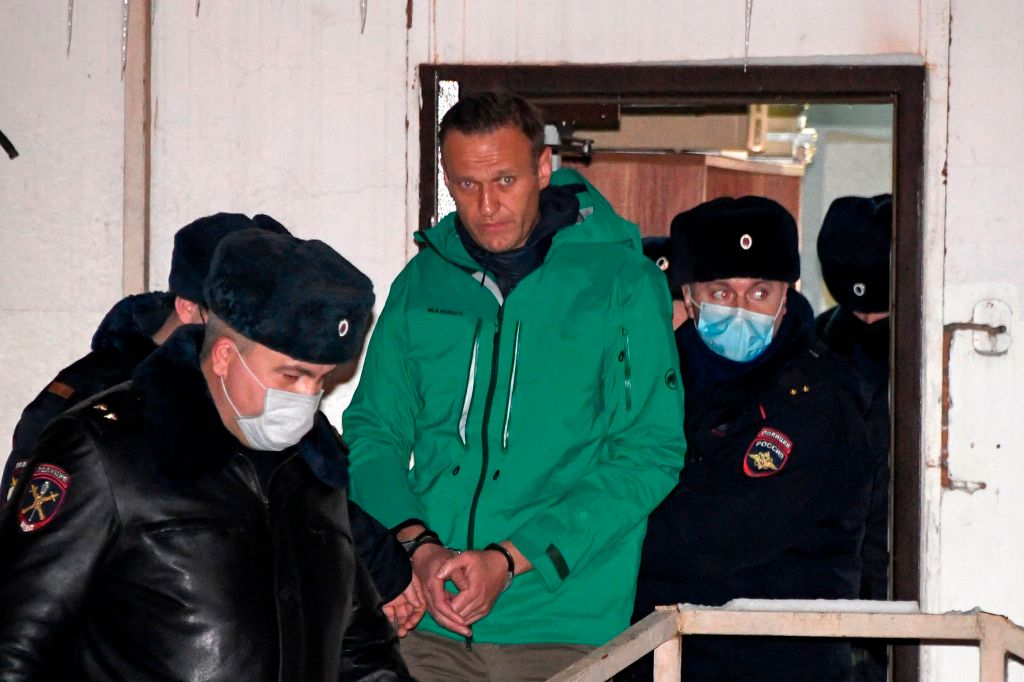 Opposition leader Alexei Navalny is escorted out of a police station on January 18, 2021, in Khimki, outside Moscow, following the court ruling that ordered him jailed for 30 days. - Kremlin critic Alexei Navalny on Monday urged Russians to stage mass anti-government protests during a court hearing after his arrest on arrival in Moscow from Germany. (Photo by Alexander NEMENOV / AFP)