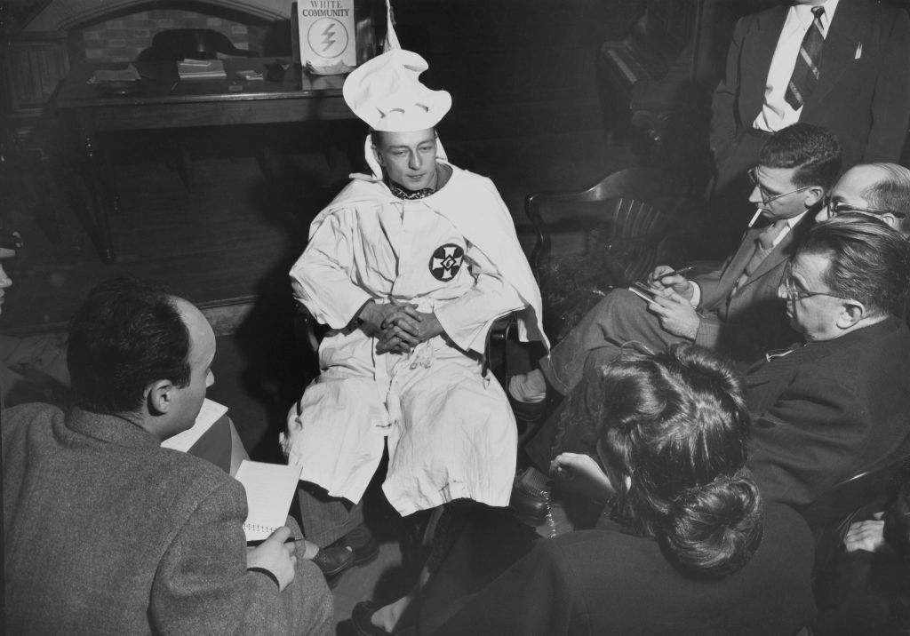 American author and human rights activist Stetson Kennedy is pictured in a Ku Klux Klan uniform ahead of his testimony against Atlanta-based neo-Nazi group The Columbians after infiltrating the group as part of a collaboration with the Georgia Bureau of Investigation, in New York, Ny. in January 1947