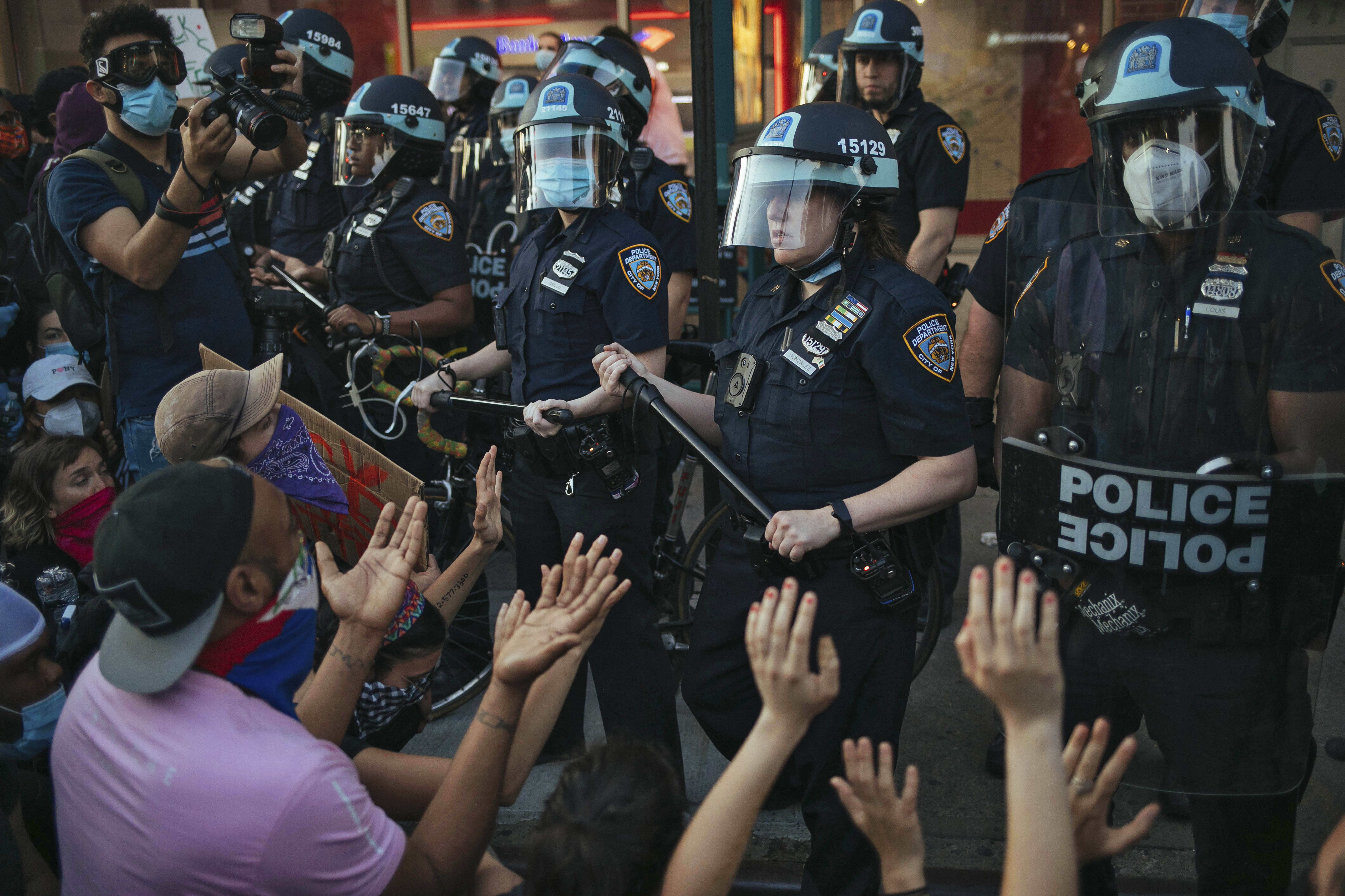 This May 31, 2020 file photo shows New York City Police facing off with activists during a protest march in the Bedford-Stuyvesant section of the Brooklyn borough of New York.