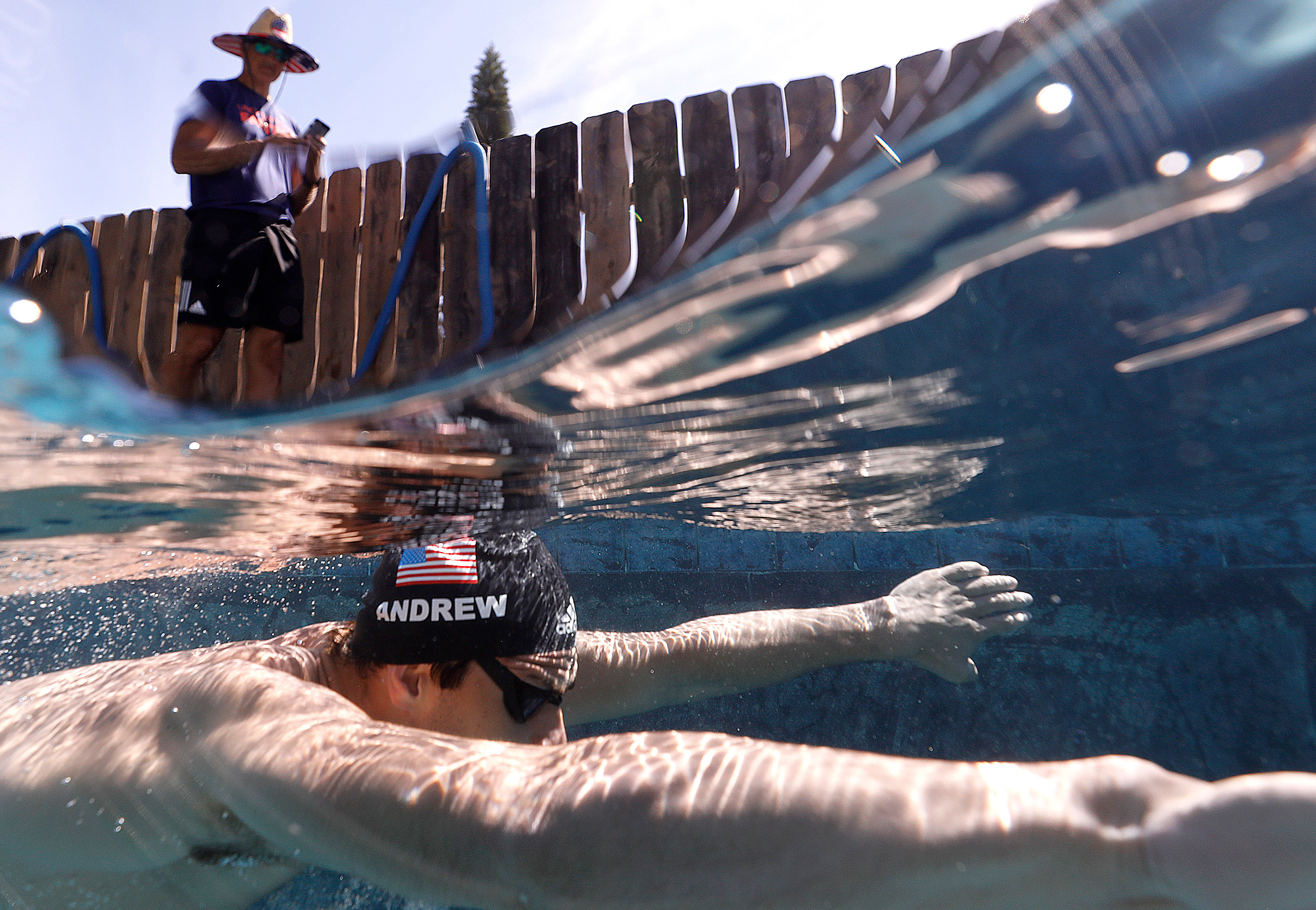 U.S. Olympic Swimmer Michael Andrew is coached by his father Peter as he trains in a residential pool in San Diego in May