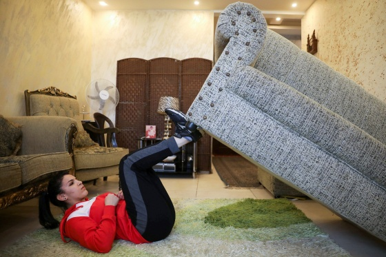 Jordanian judo practitioner Hadeel Alami uses the sofa as a part of her trainings at her home in Amman in April