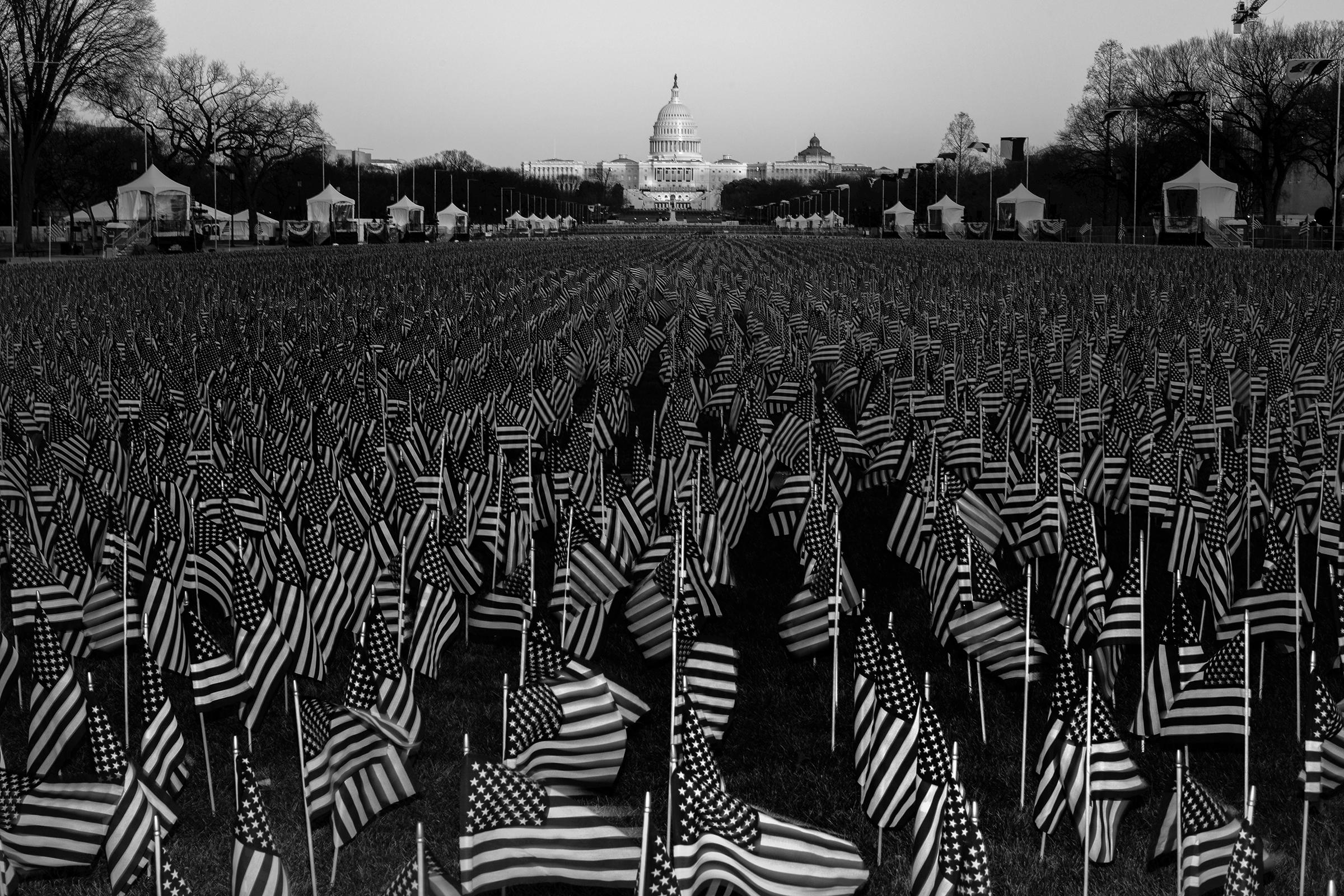 A field of flags on the National Mall in Washington, D.C., on Jan. 19, one day before the inauguration of President-elect Joe Biden and Vice President-elect Kamala Harris. The public art display features nearly 200,000 flags, representing Americans who would have gathered for the inauguration, according to the organizing committee.