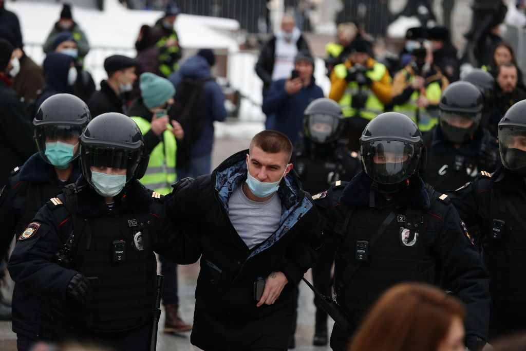 Police take protesters into custody during a protest demanding the release of Russian opposition leader Alexei Navalny in Moscow, Russia on January 23, 2021.