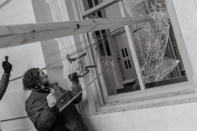 Pro-Trump rioter uses a Capitol Police shield to break a window of the U.S. Capitol in Washington, D.C.