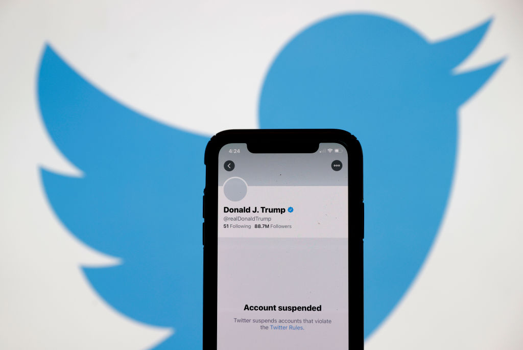 SAN ANSELMO, CALIFORNIA - JANUARY 08: The suspended Twitter account of U.S. President Donald Trump appears on an iPhone screen on January 08, 2021 in San Anselmo, California. Citing the risk of further incitement of violence following an attempted insurrection on Wednesday, Twitter permanently suspended President Donald Trump's account.