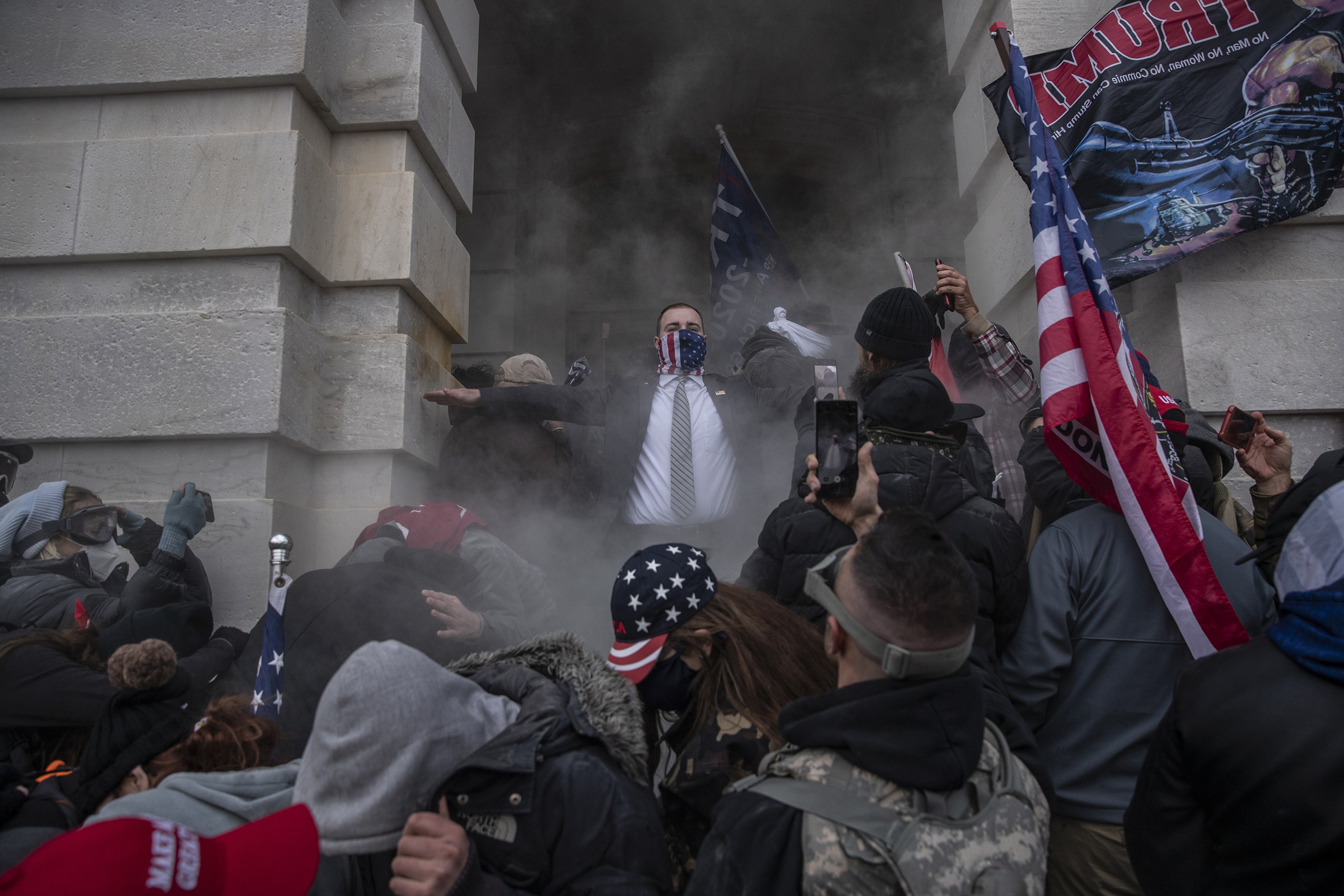 Demonstrators attempt to breach the U.S. Capitol after they stormed past barricades on Jan. 6