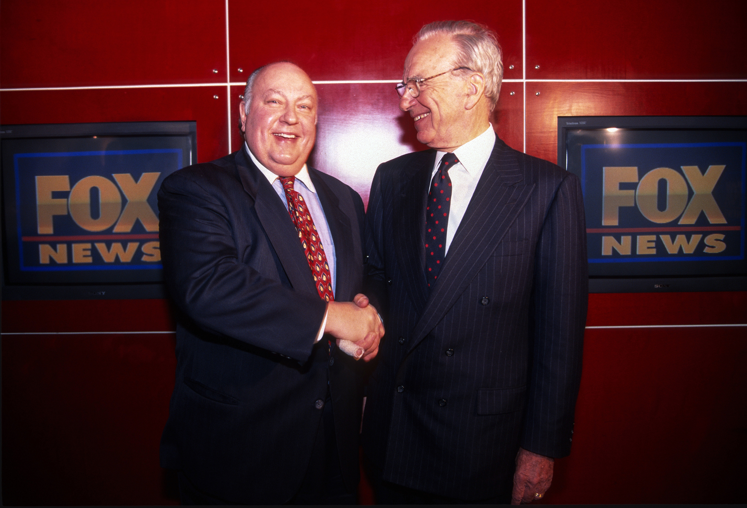 Rupert Murdoch shakes hands with Roger Ailes after naming Ailes the head of Fox News in New York City, Jan. 1996