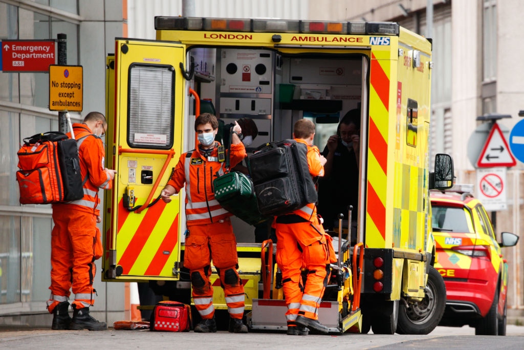 An air ambulance crew gather their belongings outside the emergency department of the Royal London Hospital in London, England, on January 26, 2021.