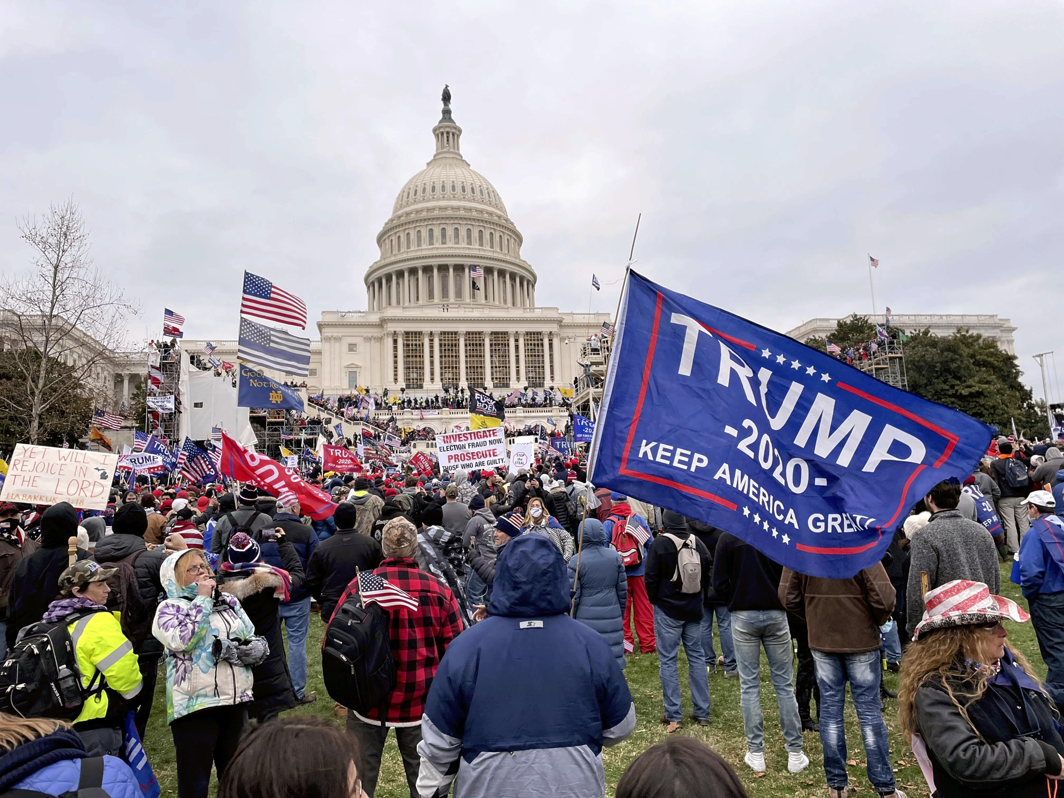 Pro-Trump protesters gather at the U.S.Capitol Hill to protest against Biden's certification in Washington, D.C. on Jan. 6, 2021. A violent pro- Trump protesters stormed into the U.S. Capitol, which has left four people killed during the turmoil at the U.S. Capitol.