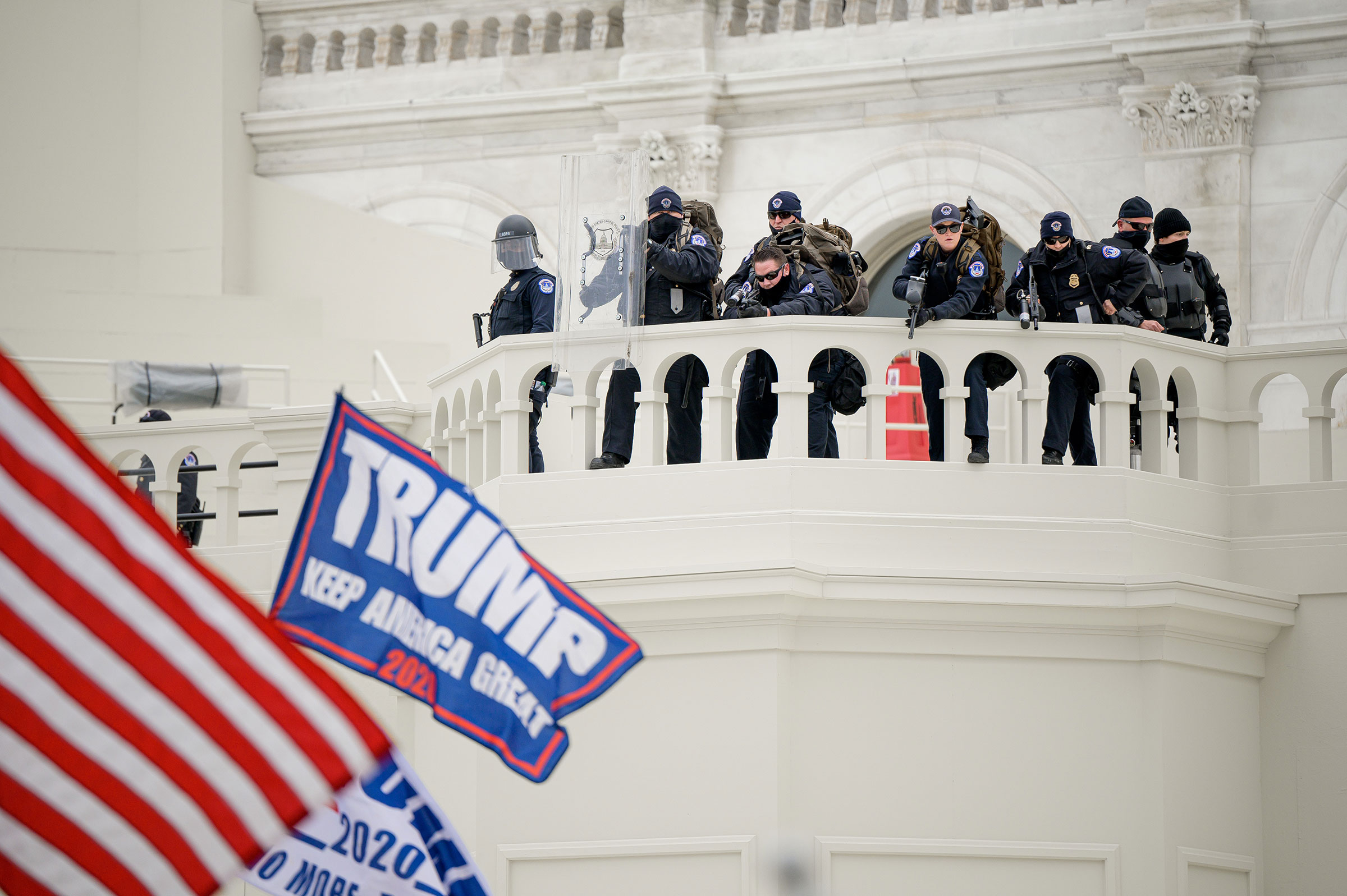 Capitol police officers take position as a pro-Trump mob attempts to enter the Capitol Building.