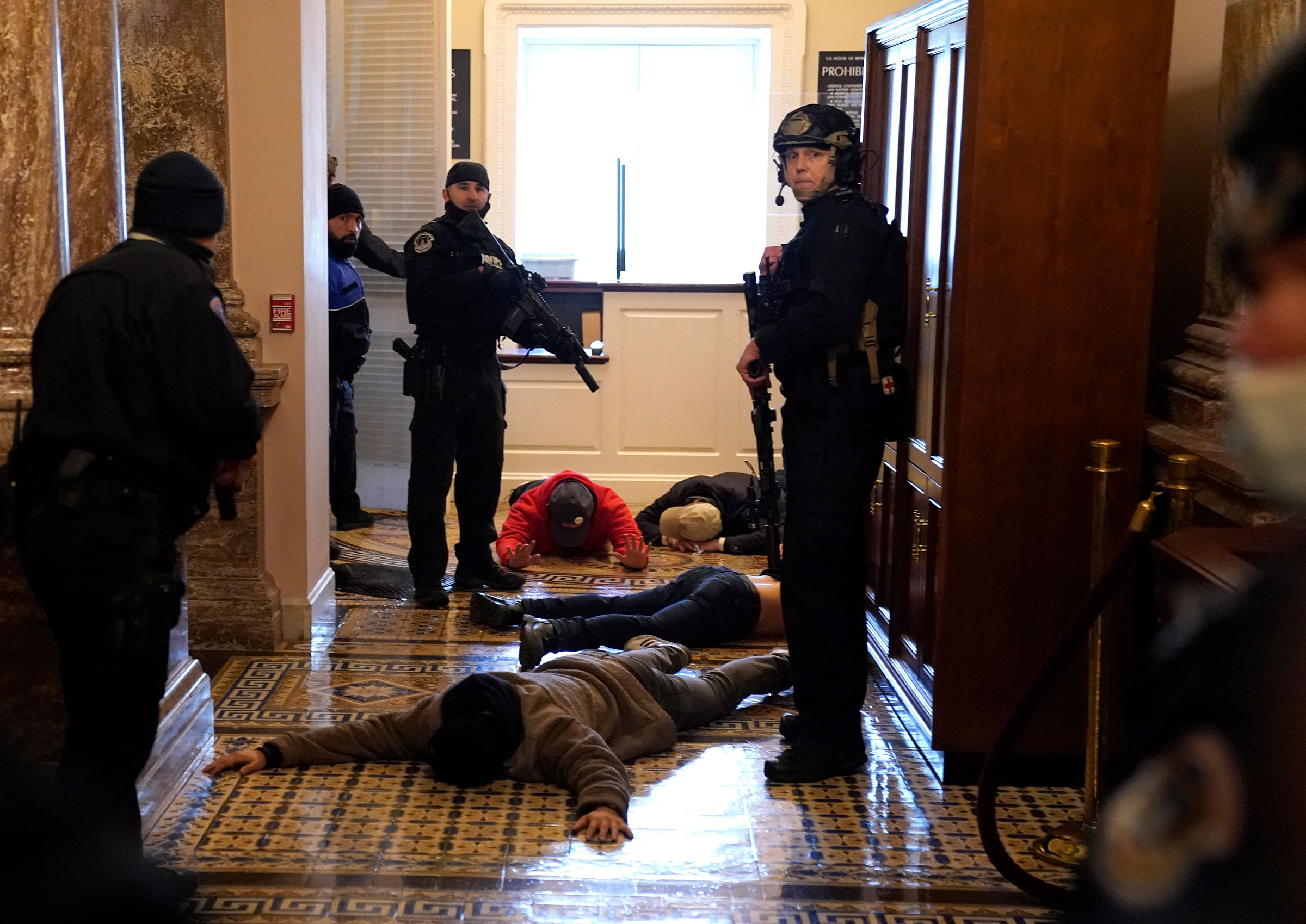 U.S. Capitol Police detain pro-Trump rioters outside of the House Chamber of the U.S. Capitol on Jan. 6.