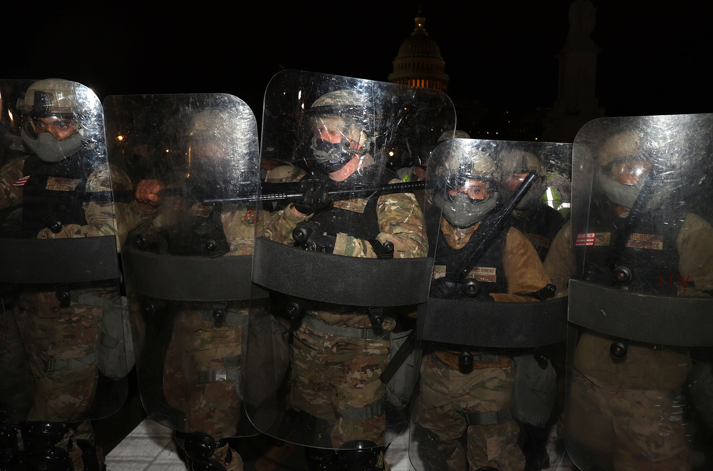 Members of the National Guard assist police officers in dispersing the mob of Trump supporters who were gathering at the Capitol.