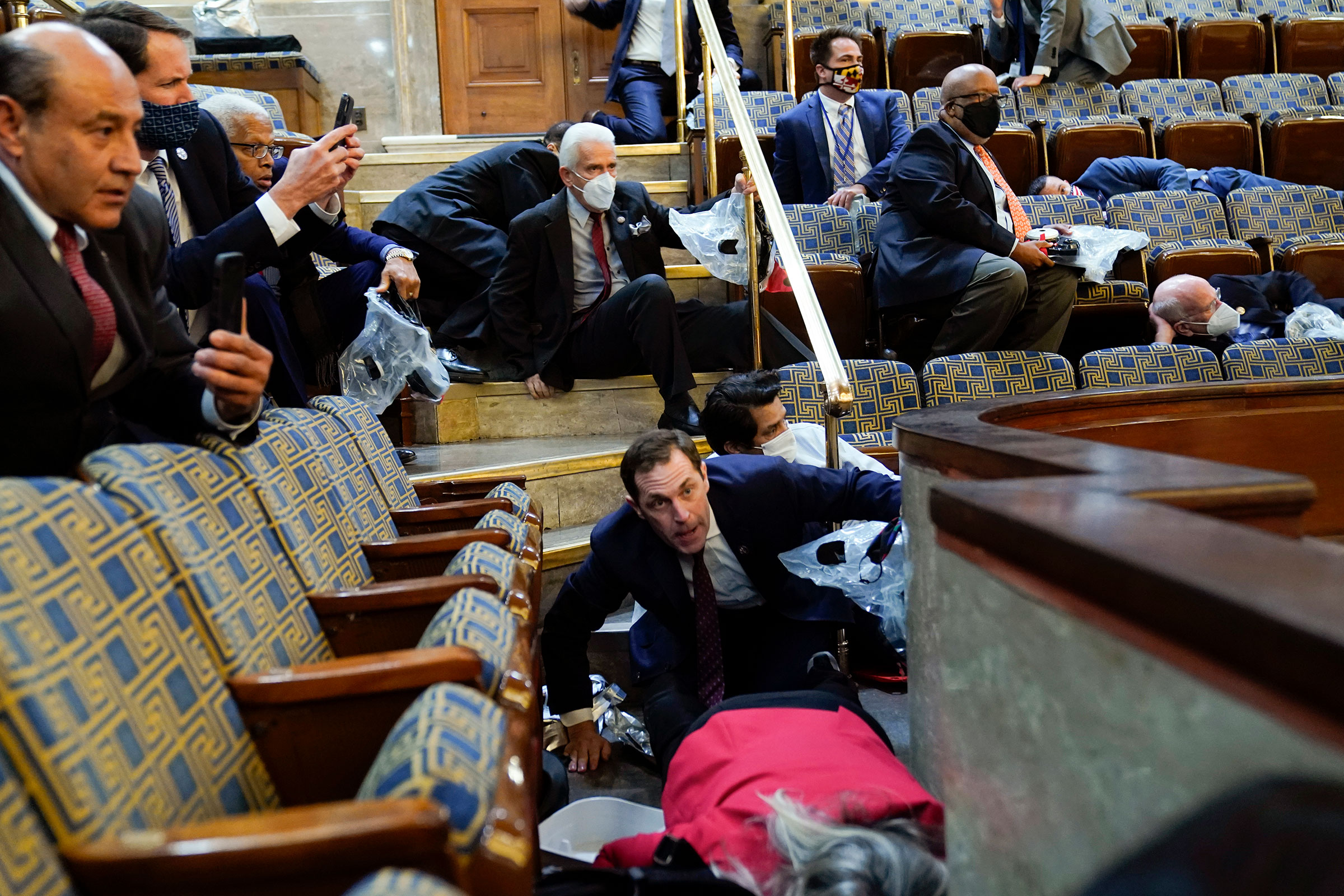 Lawmakers and staff shelter as protesters besiege the House Chamber.