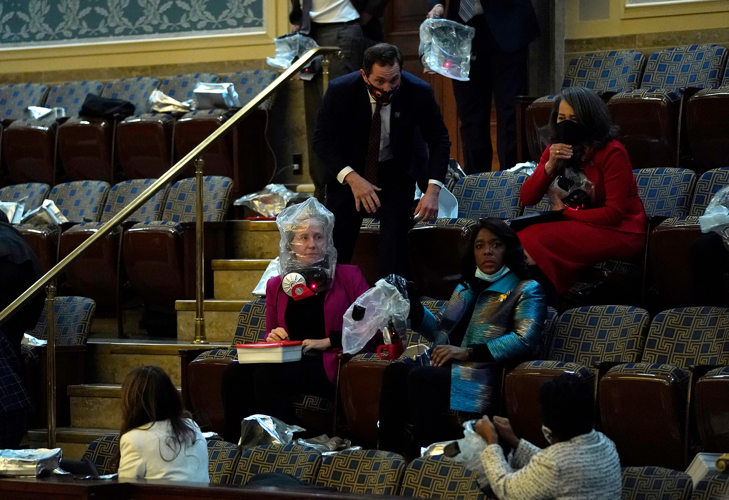 People put on gas masks while sheltering in the House Chamber.