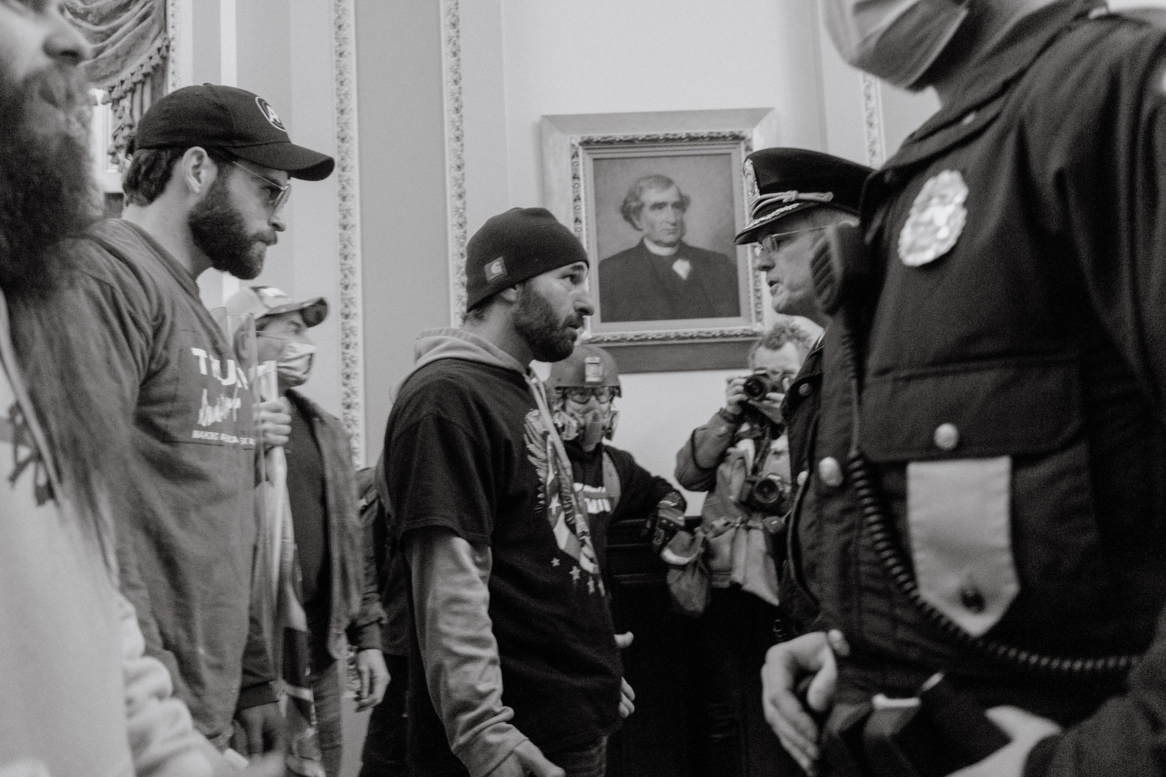 Pro-Trump rioters confront Capitol Police officers after breaking into the Capitol.