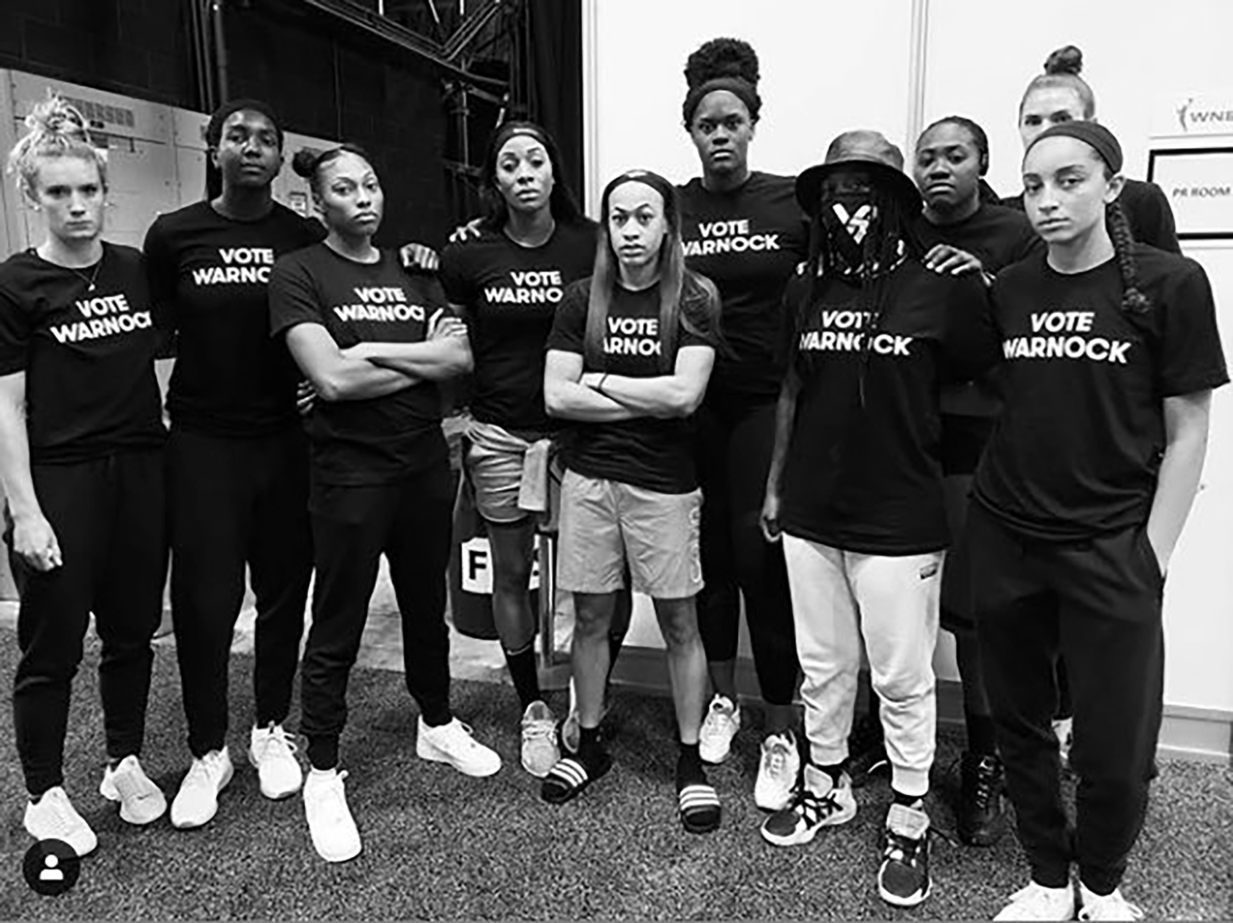Players of the Atlanta Dream wear t-shirts that read  Vote Warnock