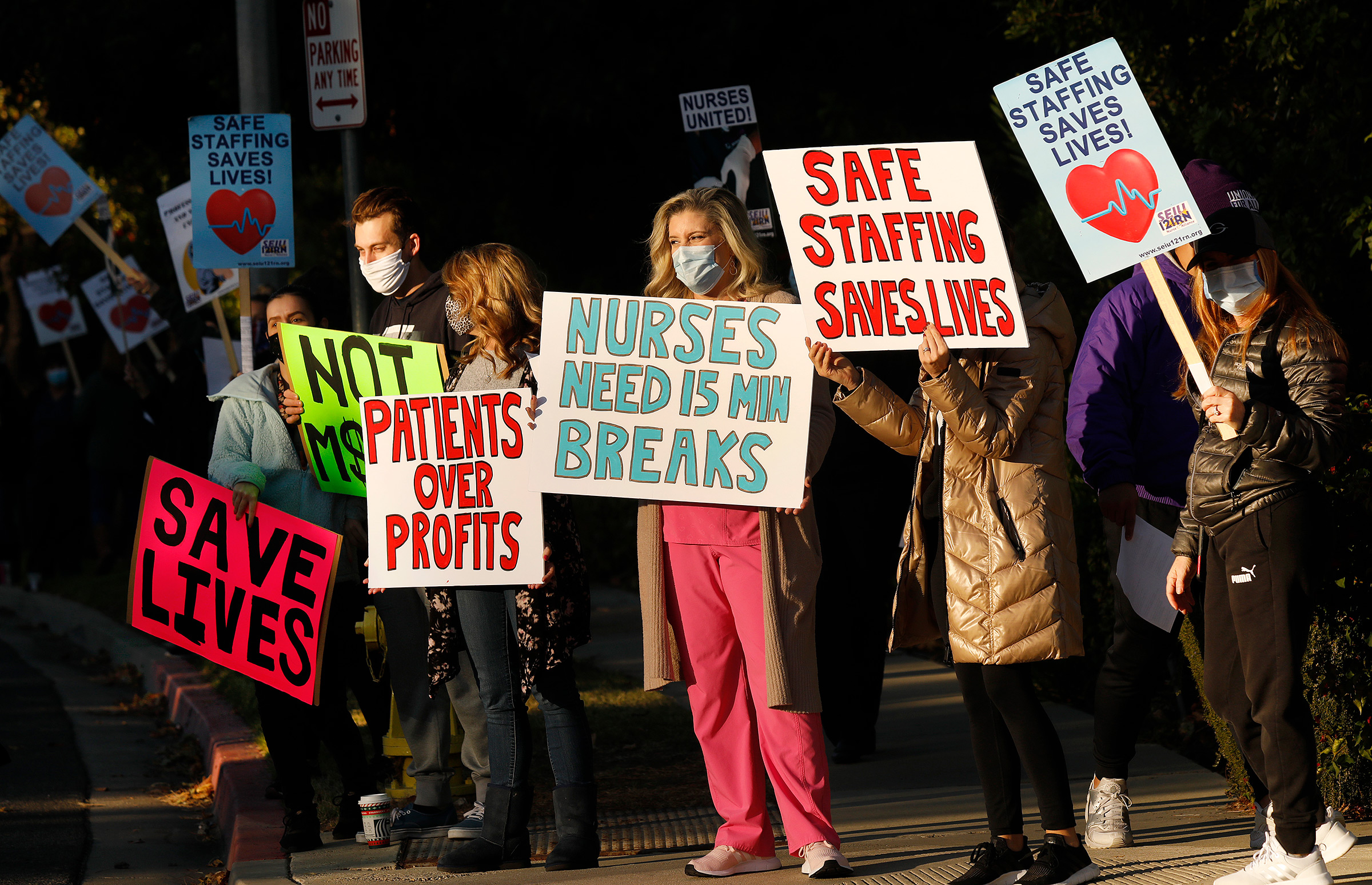 Nurses and licensed medical professionals picket in front of Los Robles Regional Medical Center to raise concerns over lack of COVID-19 testing for patients and staff, continued insufficient PPE and dangerous lack of staff on duty, in Thousand Oaks, Calif., on Nov. 30, 2020.