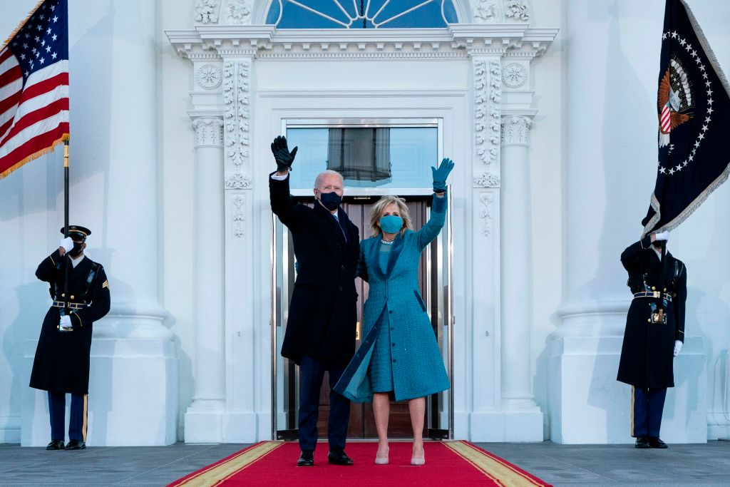 U.S. President Joe Biden and First Lady Jill Biden wave as they arrive at the White House in Washington, D.C., on January 20, 2021.