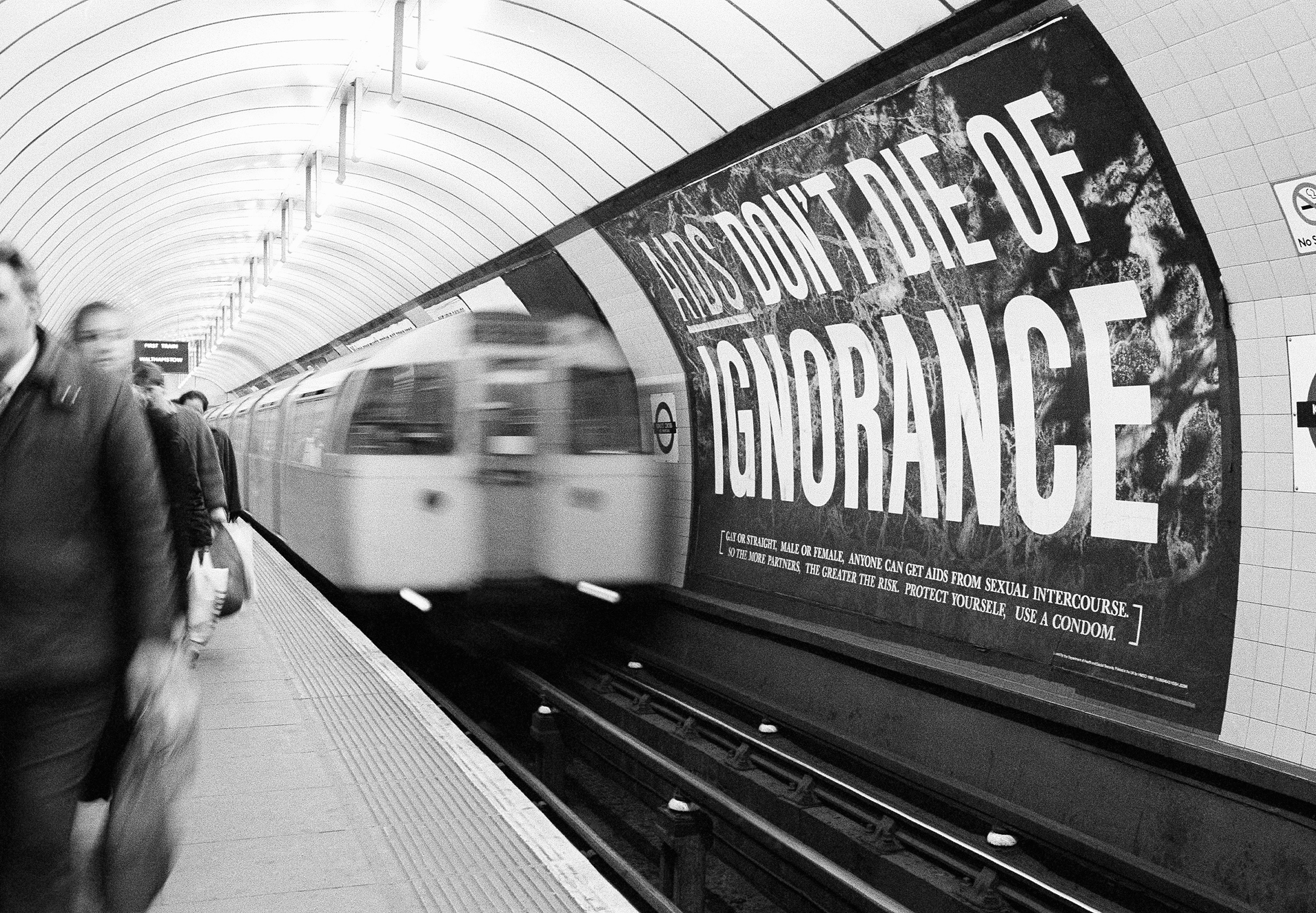 With an average of two people a day dying of AIDS in Britain, the government blitzed the nation with warning posters as part of its 20 million pound media campaign, pictured on March 5, 1987. This poster confronted passengers at the Kings Cross subway station in central London.