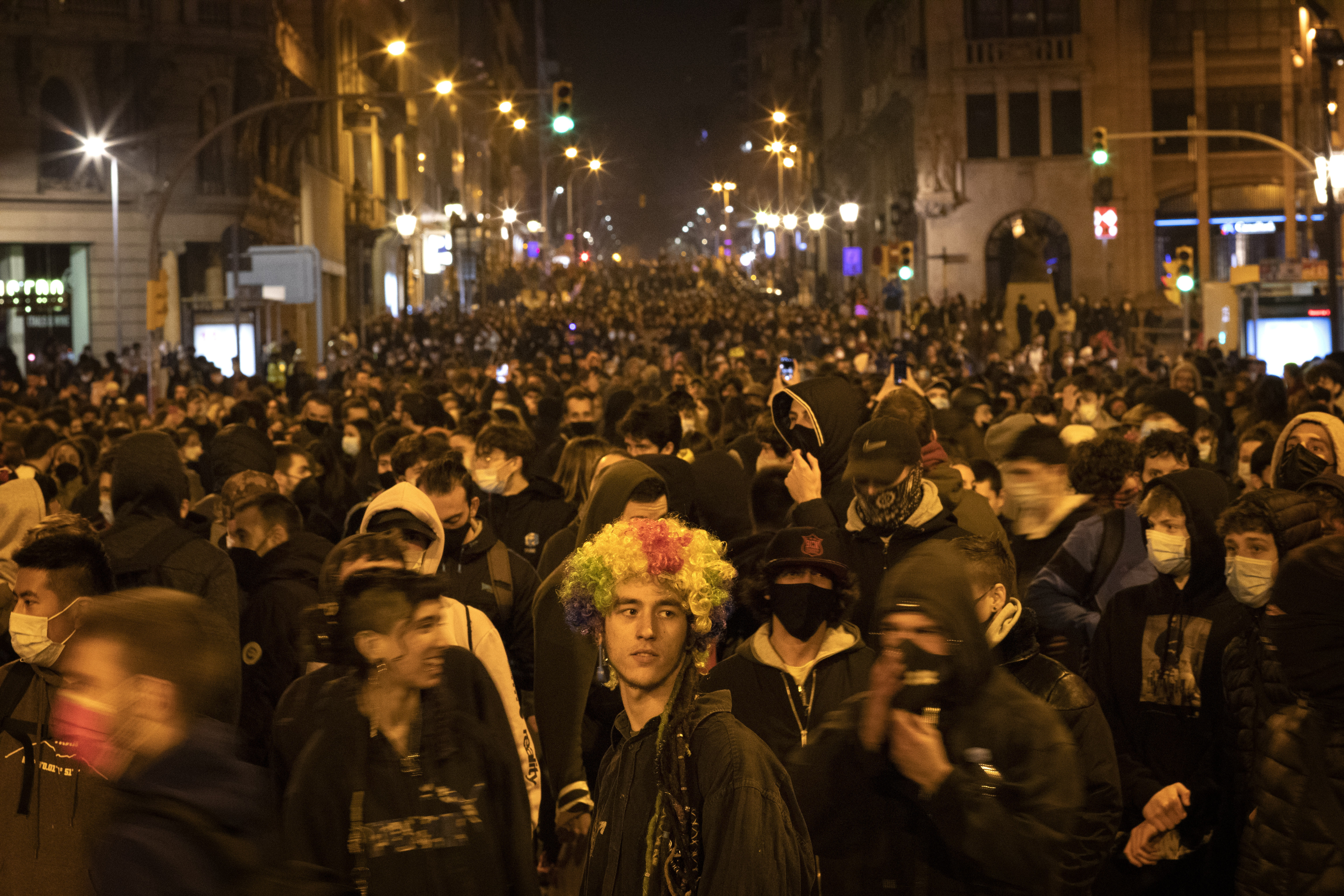 Demonstrators march during a protest condemning the arrest of rap artist Pablo Hasél in Barcelona, Spain, Friday, Feb. 19, 2021.