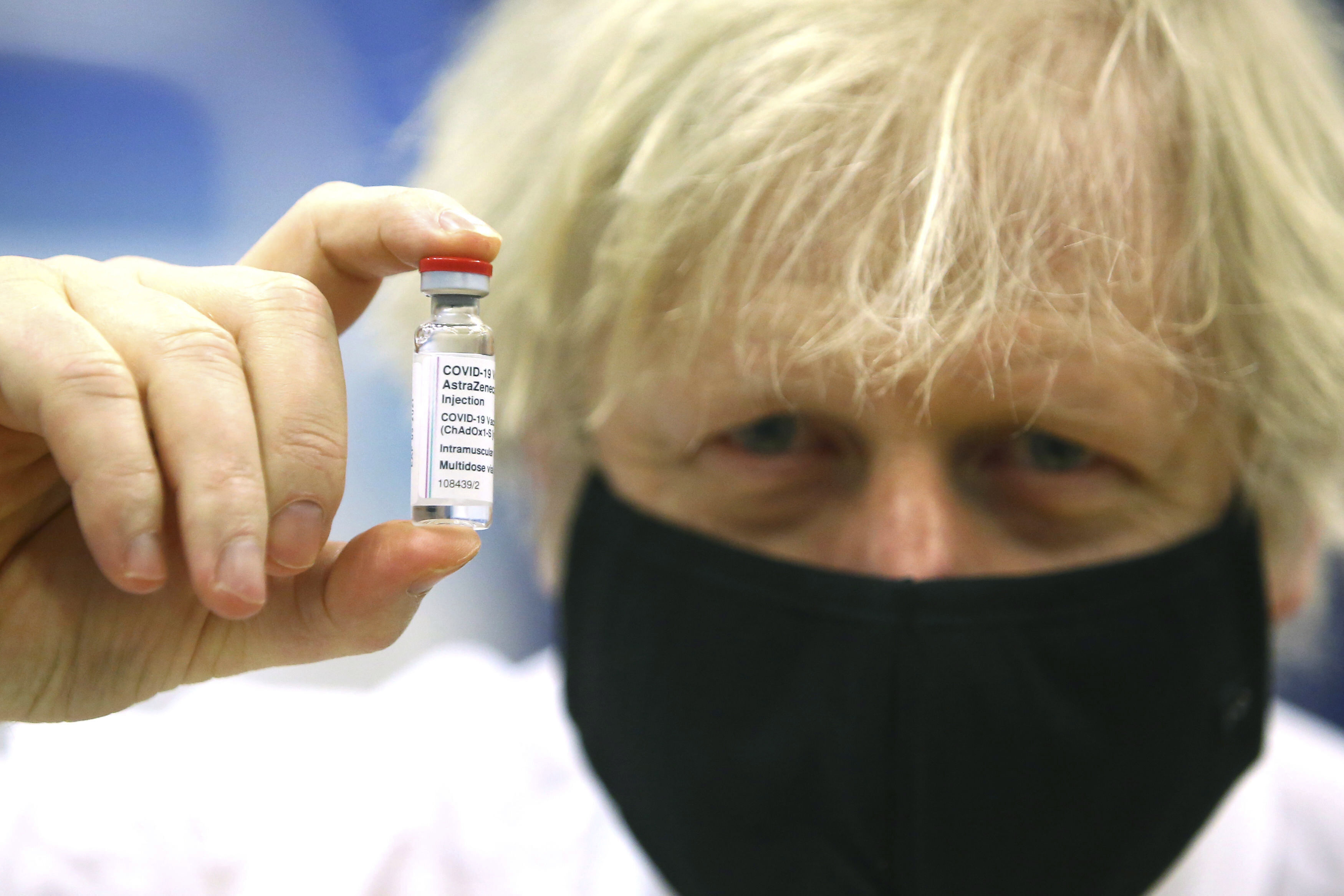 Britain's Prime Minister Boris Johnson holds a vial of the Oxford/Astra Zeneca Covid-19 vaccine at a vaccination centre in Cwmbran, south Wales, on Feb. 17, 2021.                       (Geoff Caddick/Pool via AP, File)