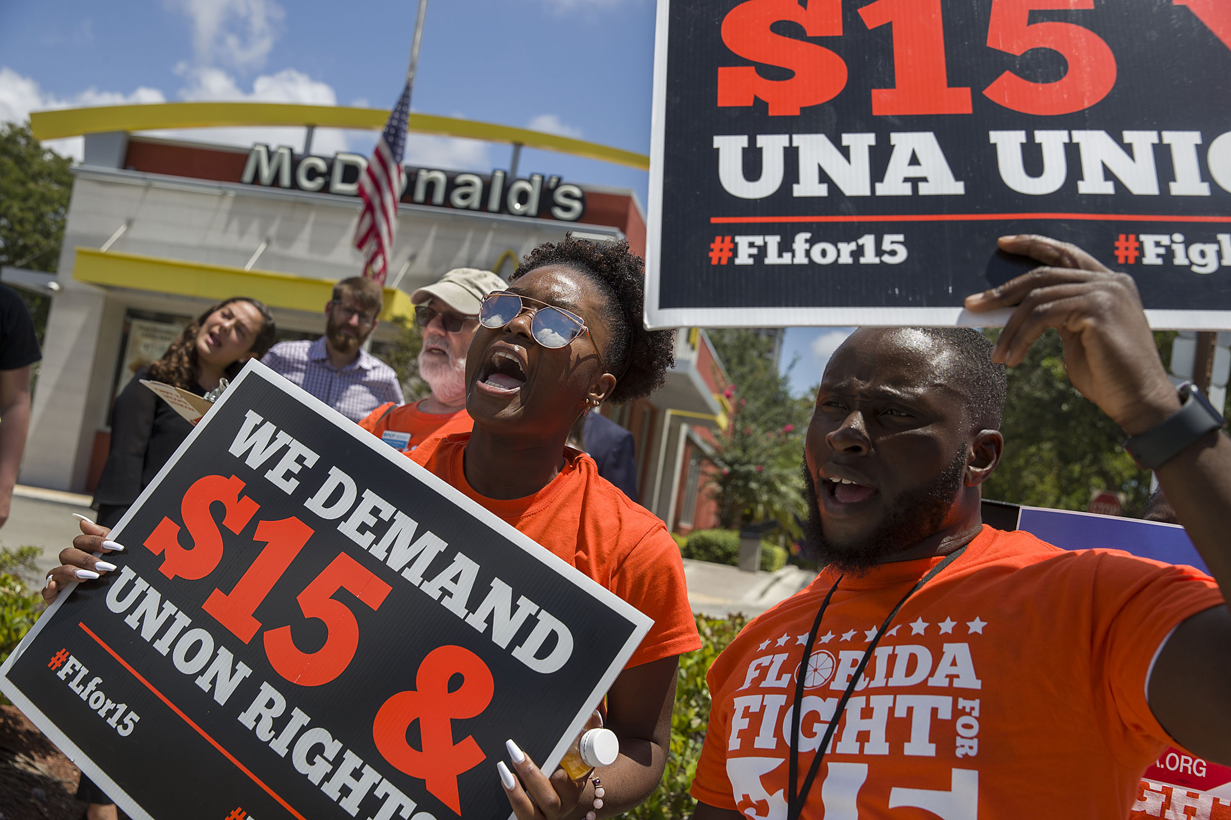 People gather together to ask  the McDonald's corporation to raise workers wages to a $15 minimum wage in Fort Lauderdale, Florida,  on May 23, 2019.