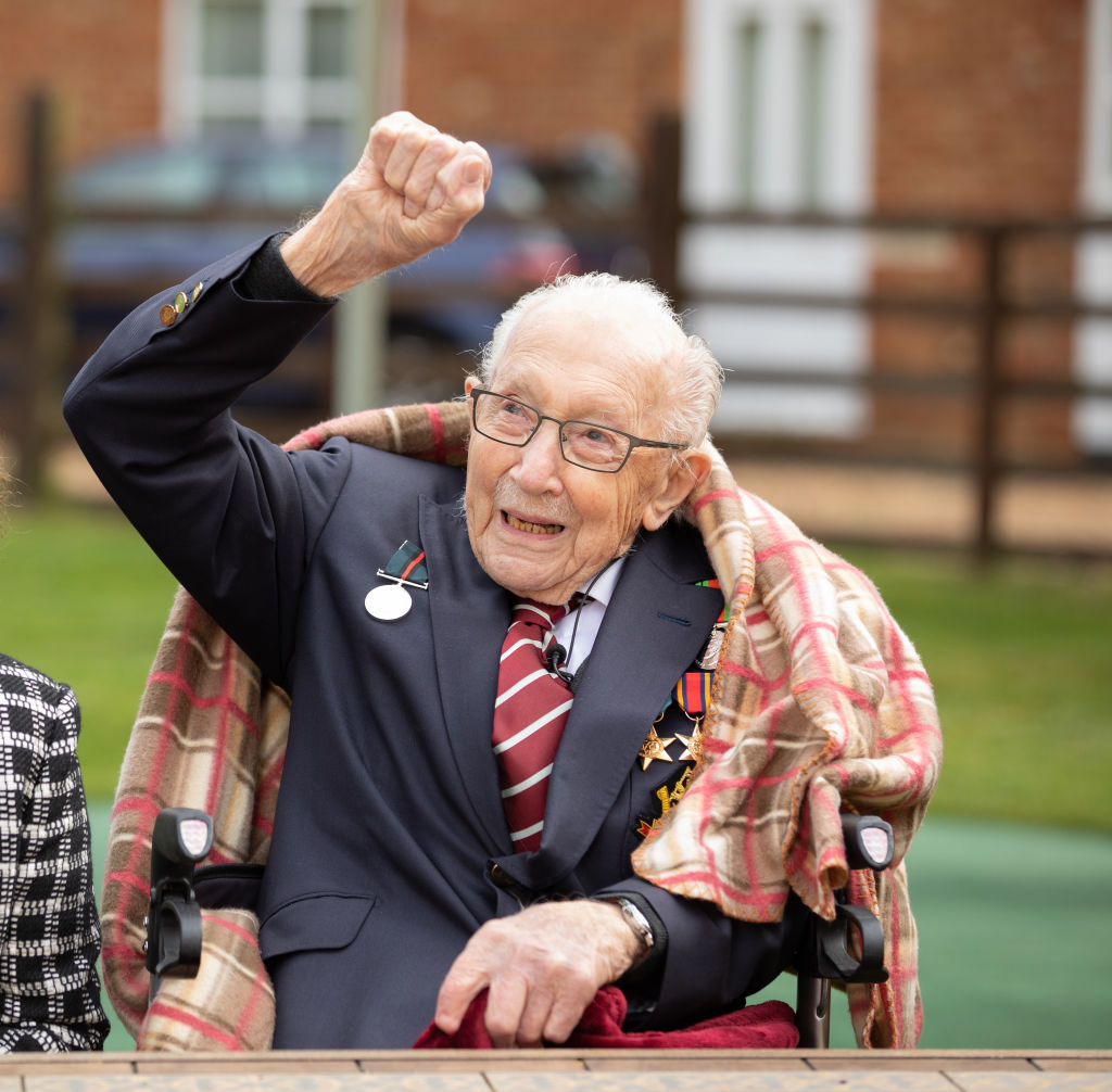 Colonel Tom Moore celebrates his 100th birthday on April 30, 2020 with an RAF flypast provided by a Spitfire and a Hurricane over his home in Marston Moretaine, England