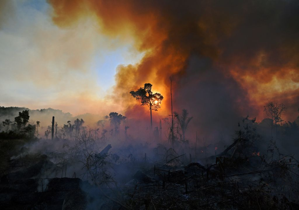 Smoke rises from an illegally lit fire in Amazon rainforest reserve, south of Novo Progresso in Para state, Brazil, on Aug. 15, 2020