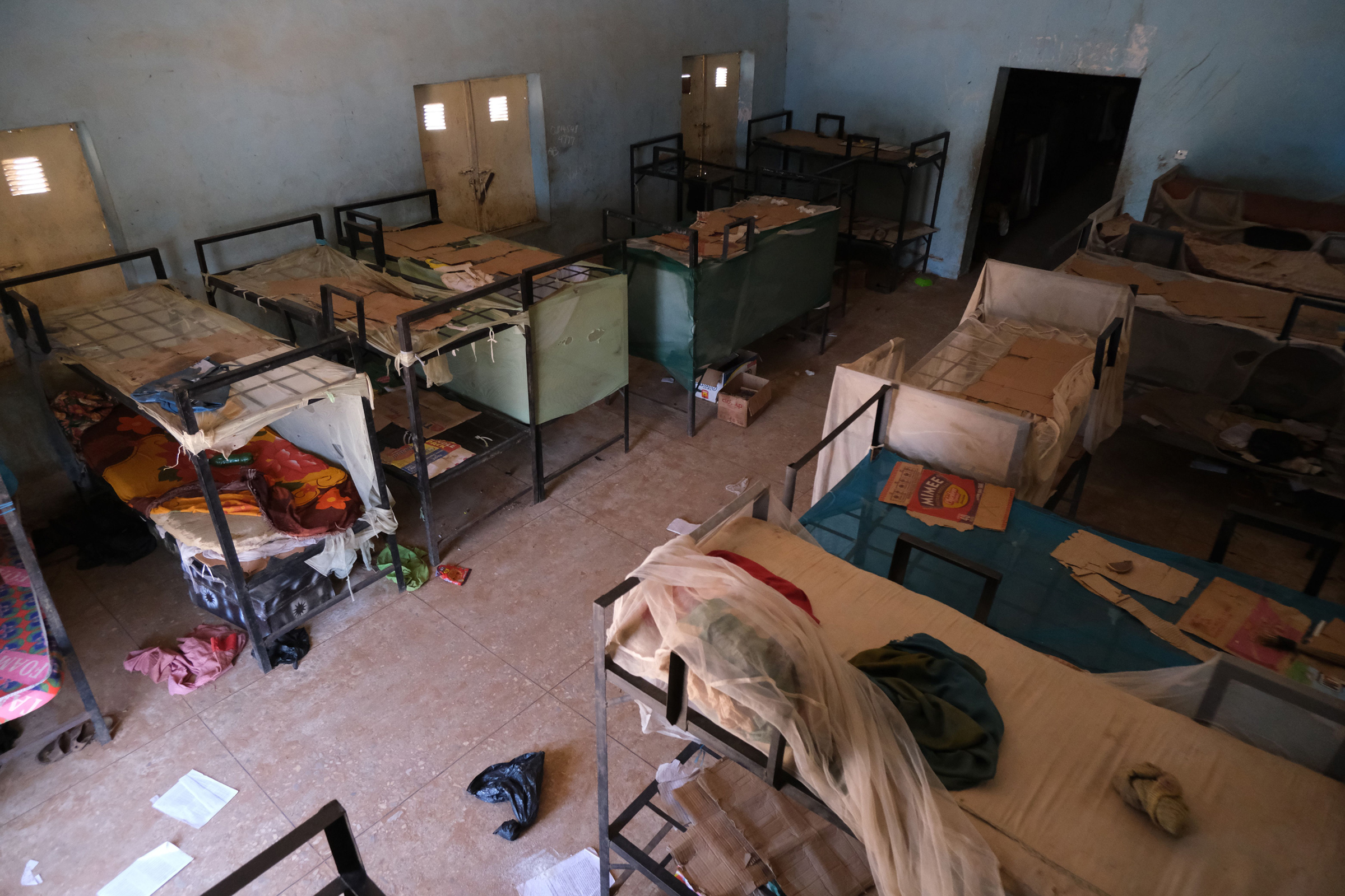 An empty dormitory full of schoolboys' items is seen after gunmen abducted students at the Government Science school in Kankara, Nigeria on Dec. 15, 2020.
