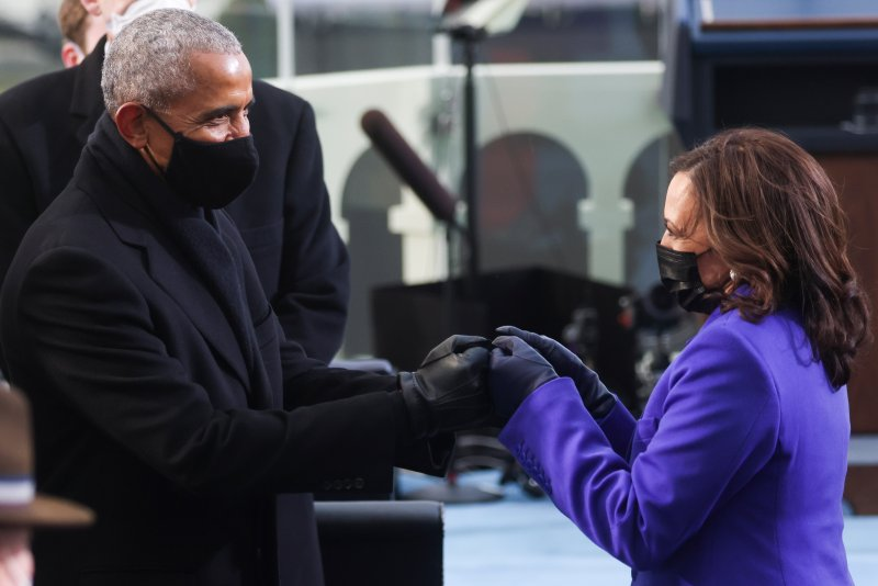 Barack Obama, the nation's first Black President, and Kamala Harris, the nation's first Black and first female Vice President, greet each other at the inauguration of President Joe Biden and Harris in Washington D.C. on Jan. 20, 2021.
