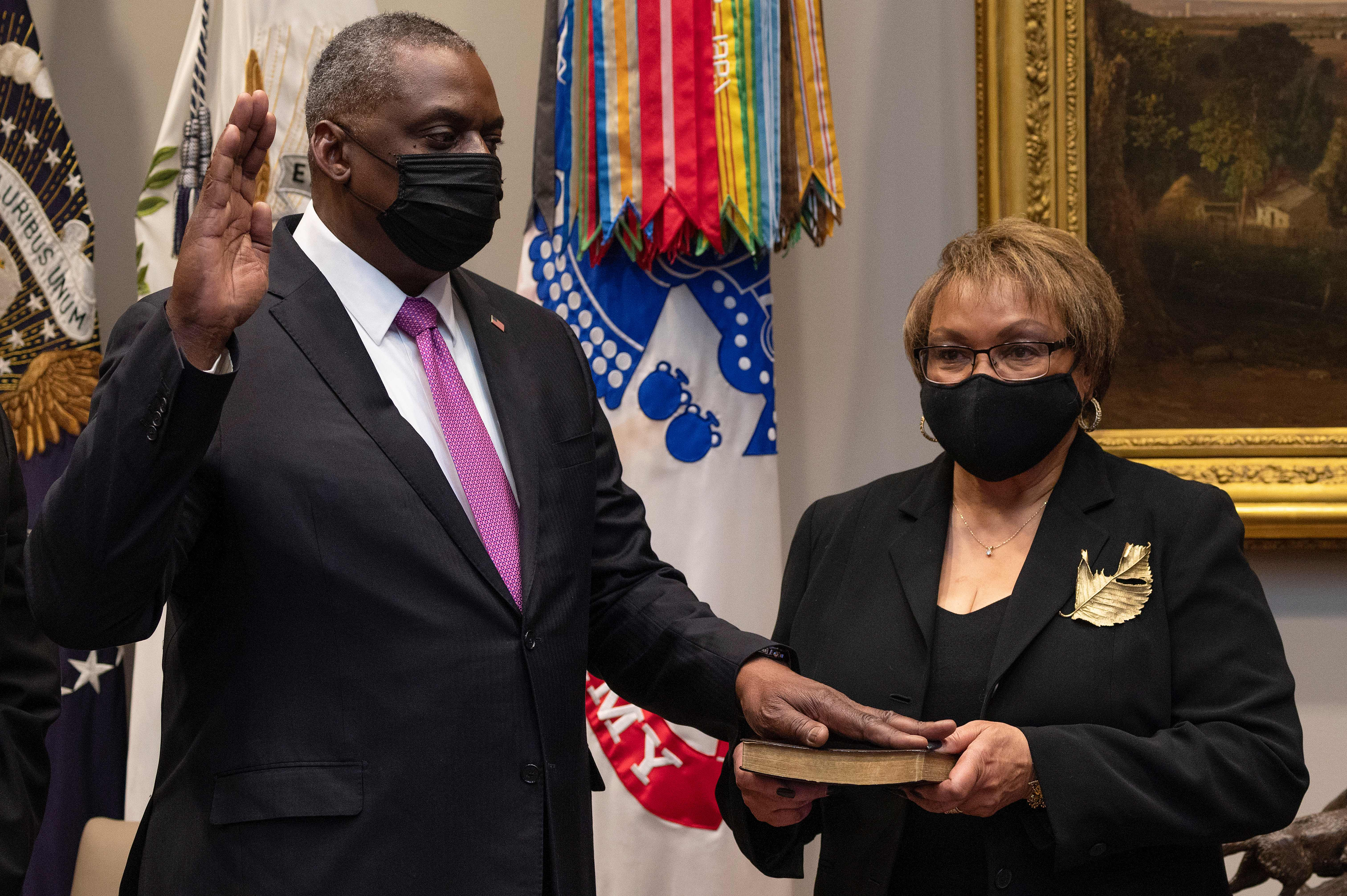 Lloyd Austin, a retired U.S. Army four-star general, is sworn in as Secretary of Defense as his wife, Charlene Austin, holds the Bible in Washington D.C. on Jan. 25, 2021.