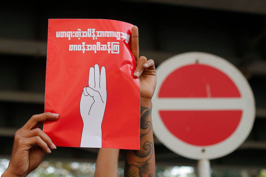 A Myanmar protester holds a placard during a demonstration against military coup in Yangon, Myanmar on February 7, 2021.