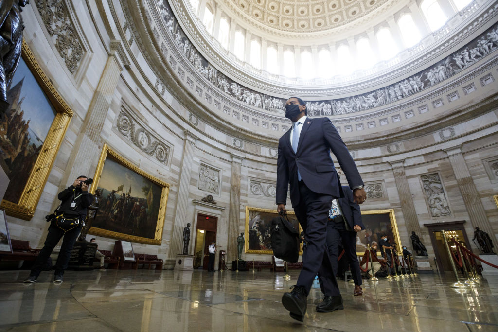 Rep. Joe Neguse, a Democrat from Colorado, walks through Statuary Hall at the U.S. Capitol in Washington, D.C., on Feb. 10, 2021.