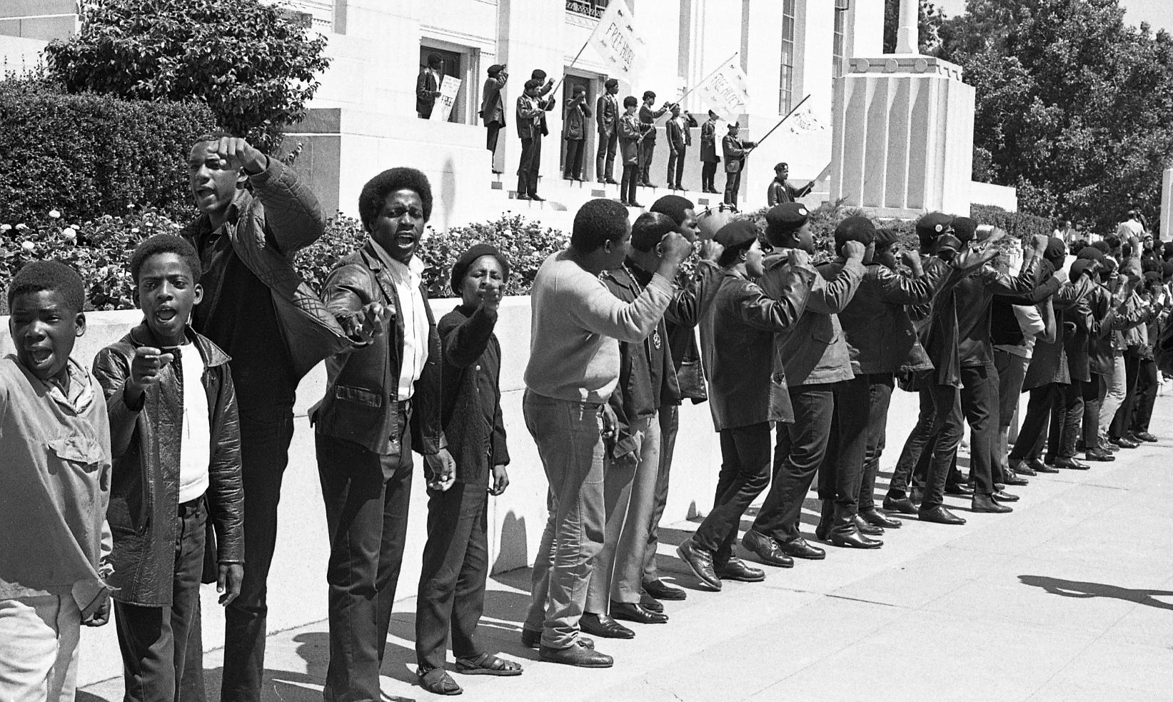Demonstrators rally outside Huey Newton's murder trial in Oakland in 1968.