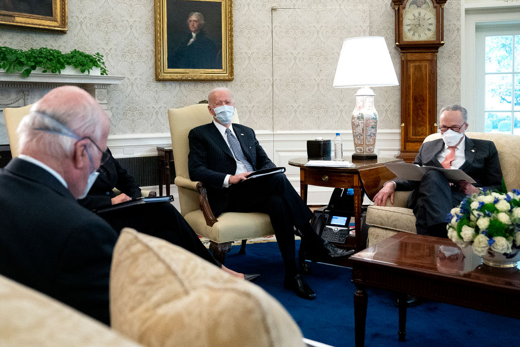 U.S. President Joe Biden, center, meets with Sen. Patrick Leahy (D-VT) (L), Senate Majority Leader Charles Schumer (D-NY) and other Democratic senators to discuss his $1.9 trillion American Rescue Plan in the Oval Office at the White House in Washington, DC, on February 03, 2021.
