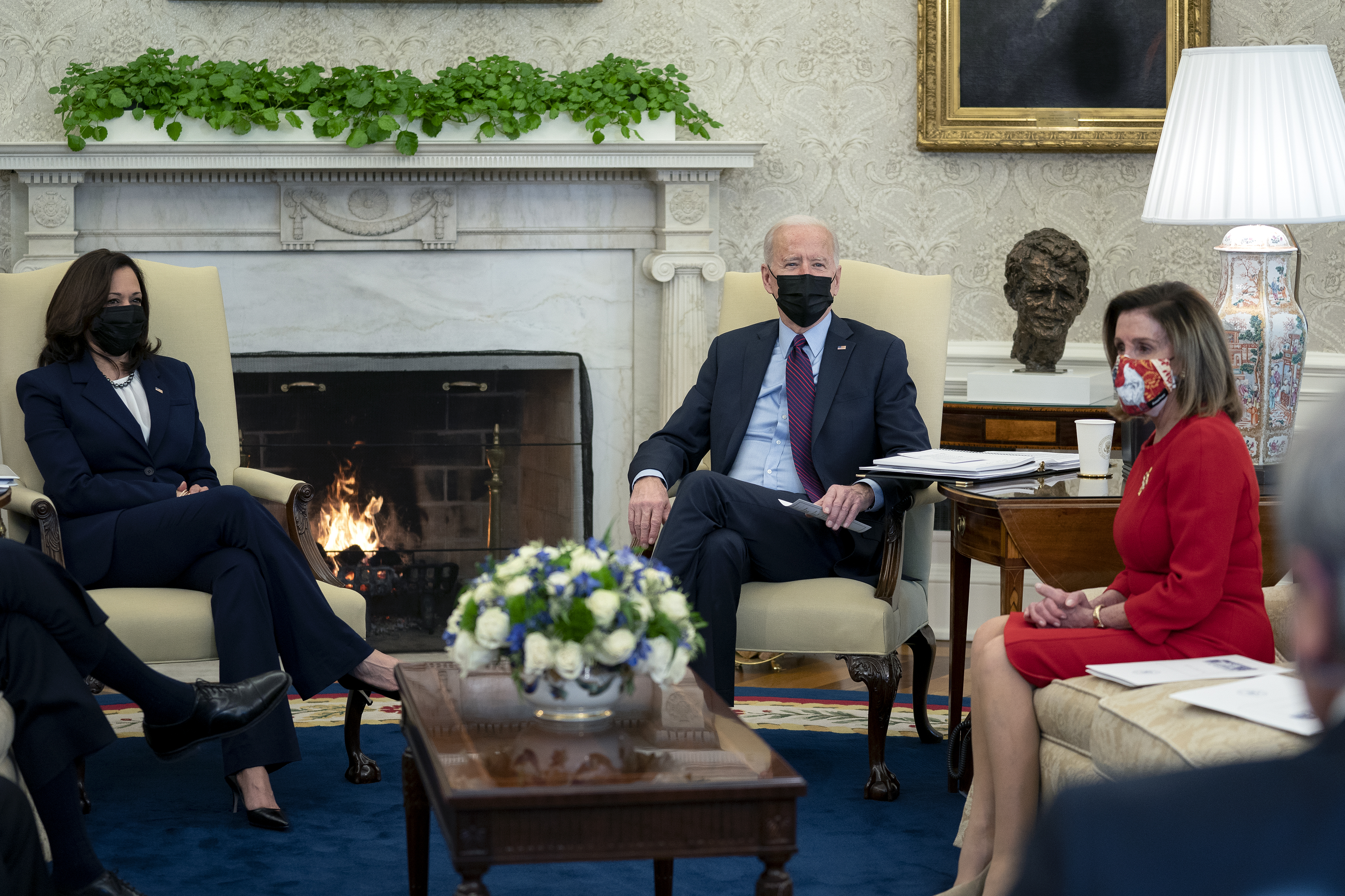 President Joe Biden, center, U.S. Vice President Kamala Harris, left, and U.S. House Speaker Nancy Pelosi, a Democrat from California, wear protective masks during a meeting in the Oval Office of the White House in Washington, D.C., U.S., on Friday, Feb. 5, 2021. The Senate voted 51-50 to adopt a budget blueprint for Biden's $1.9 trillion virus relief package following nearly 15 hours of wading through amendments from both parties.