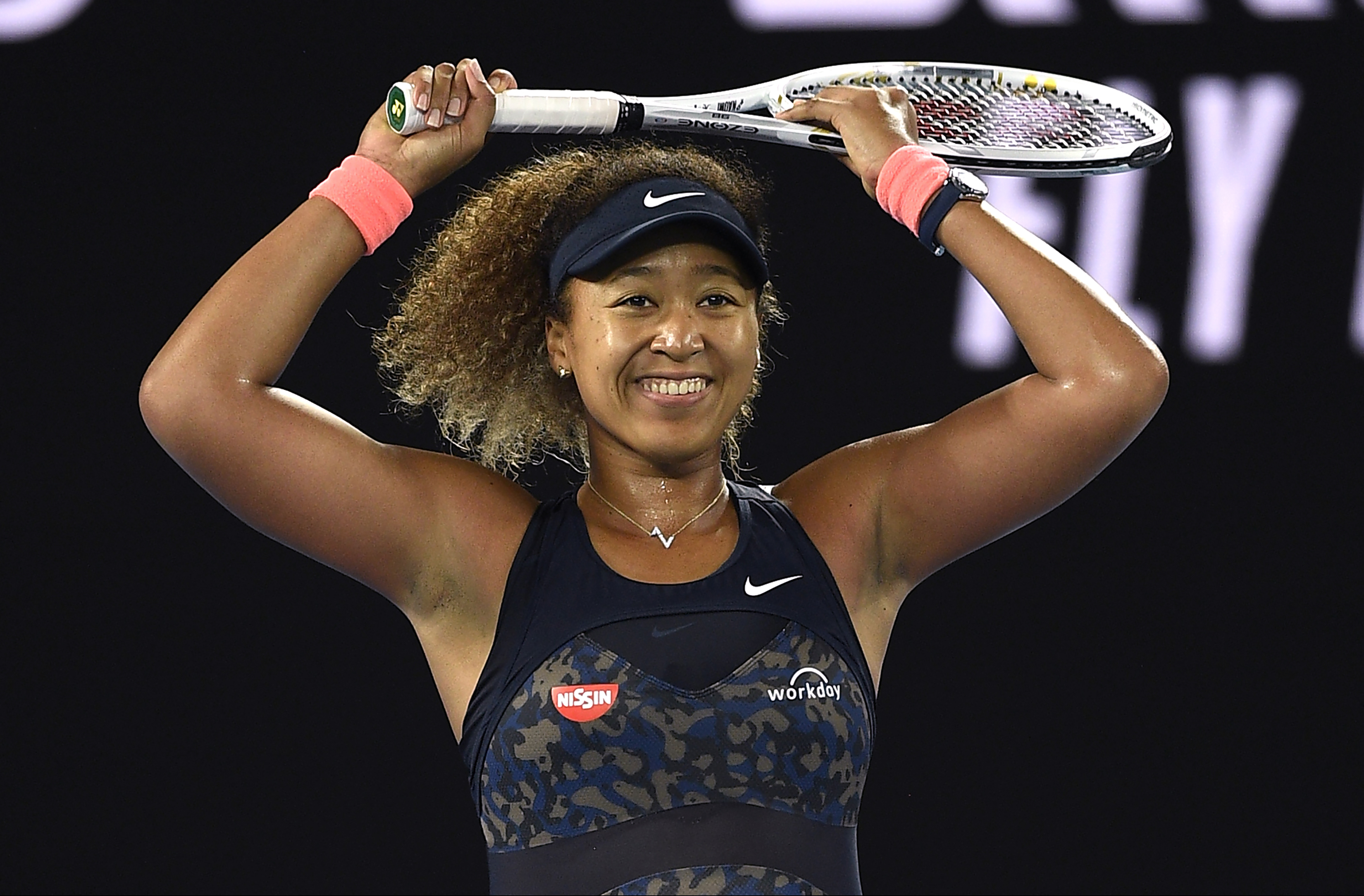 Japan's Naomi Osaka celebrates after defeating United States' Jennifer Brady during the women's singles final at the Australian Open tennis championship in Melbourne, Australia, on Feb. 20, 2021.